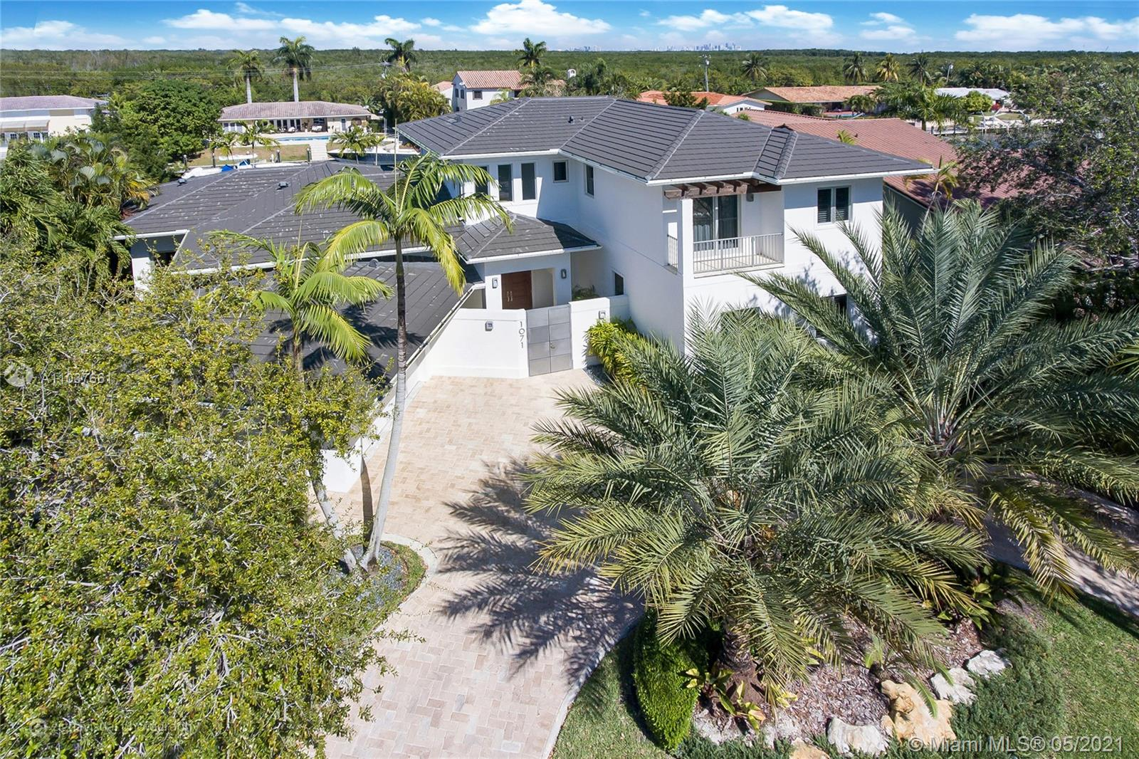 """Boater's dream-completely rebuilt in 2013 contemporary 2-story, gated community """"Gables by the Sea"""". 100ft dock, no bridges to the ocean, 10-12ft ceiling, high-end appliances (Miele, Wolf, Sub-Zero, Gaggenau), ItalKraft kitchen cabinets, gorgeous finishes, maid's quarters, barbeque, heated pool, 2-car garage, plenty of storage, high impact windows, 5 en-suit bedrooms, 7 full bathrooms, den with built-in library, ADT security system, community park."""
