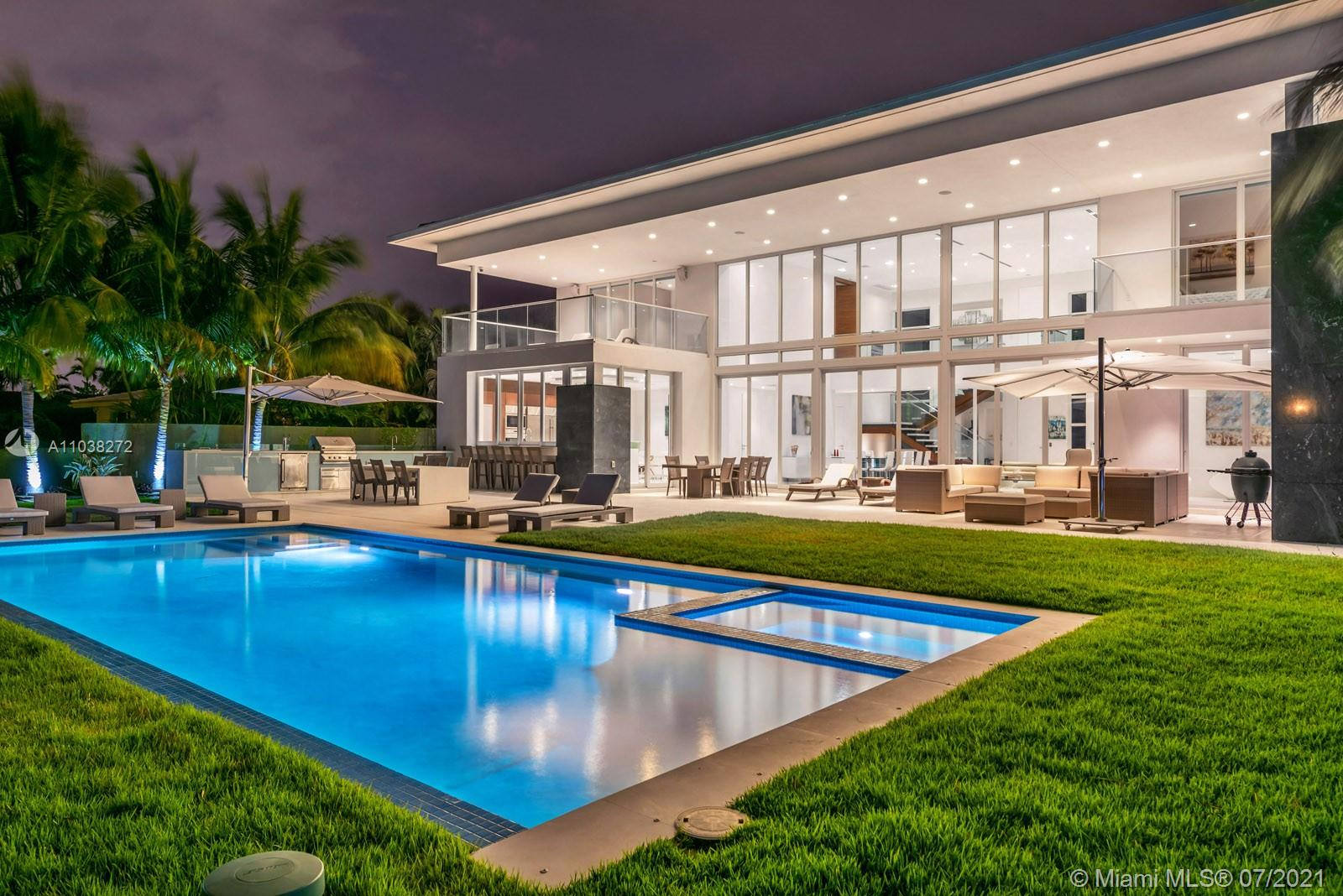 Contemporary waterfront estate in Golden isles, one of S. Florida's most sought-after waterfront communities. Large lot (90' x 150'), southern exposure, quiet cul-de-sac street, deep water, ocean access & no fixed bridges to ocean.  Deeded Dock for large vessel.  Spanning over 6,600 sq.ft. 5BR/6BA, including a sumptuous master suite with private terrace, ideal for relaxation and entertaining.  Bright and spacious living area allows for an enviable indoor-outdoor lifestyle, walls of glass lead to the lush backyard, pool area and summer kitchen.  The home is superbly equipped with a custom home theater, gourmet kitchen, bar and open dining area.  Other appointments: elevator, motorized window treatments, home automation & lighting control.  Nearby restaurants, shops, beach and more.