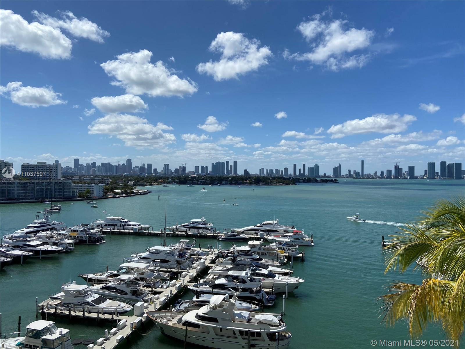 Rare Sunset Harbour bay facing unit in pristine condition. Enjoy spectacular sunsets from your balcony overlooking the Miami skyline & the Venetian Islands. A perfect split level 2 bedroom floor plan with panoramic water views from all rooms. The unit has been upgraded with beautiful hardwood floors, all impact glass doors & windows and offers plenty of closet space as well as an extra storage unit. Amenities include exclusive access to Yacht Club's half size Olympic swimming pool, hot tub, gym, sauna, BBQ, and a large bay facing club room incl. billiard table. Also there's plenty of storage space for your bicycles, kayaks & paddle boards. Sunset Harbour has it all: Marina, park, restaurants & boutiques, a co-working space, several gyms & supermarkets.