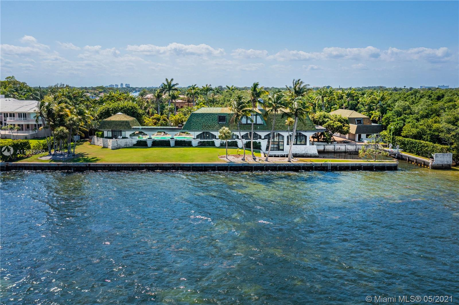 This magnificent gated 3-story bayfront estate located in exclusive Gables Estates sits directly on Biscayne Bay on an impressive 114,882 SF lot with 340+/-FT of WF, a tennis court, amazing open bay & Downtown Miami views. Features 10BR/11+2BA, exquisite marble floors, soaring ceilings, impressive living & dining room facing the open bay. Sports a chef's kitchen w/top-of-line appliances, an office, a beauty salon & family entertainment room w/pool table & a bowling alley. Sumptuous principal suite with a fireplace, bay views & beautiful principal marble bathroom w/spa tub, large marble rain shower & custom designed walk-in closet. Outdoor gardens w/fountains, private 2-story Bayfront guest house, a large pool, protected dock and access to the Atlantic Ocean complete this amazing estate.