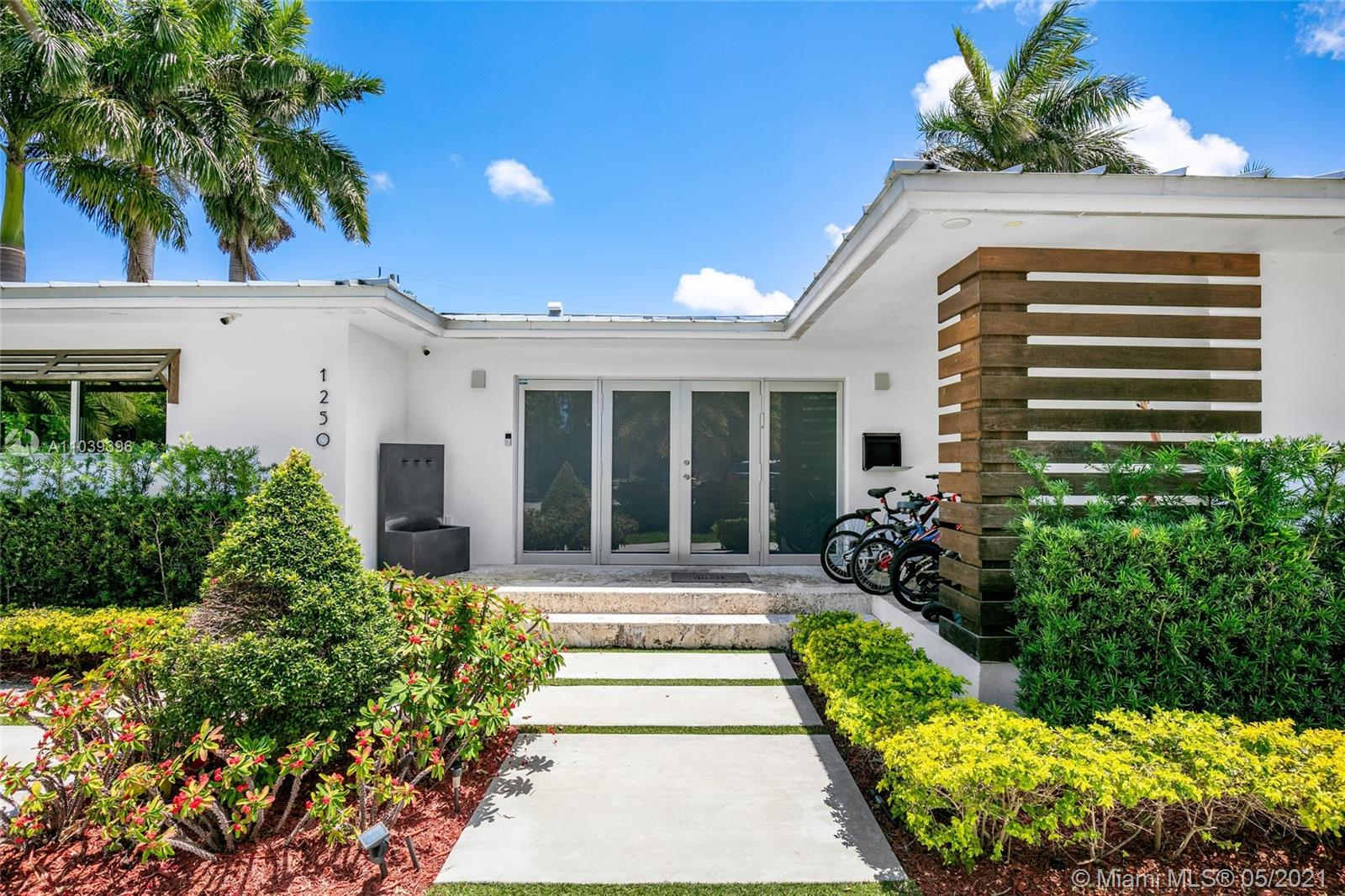 2,886 Square Foot Contemporary Gem located in Prestigious Bay Harbor Islands. This newly renovated 4bd/4ba home features an open concept w/ state of the art custom finishes. Completely rebuilt from the foundation, exterior walls & roof trusses. All en-suite baths + cabana bath perfect while enjoying new pool. Porcelain floors thru-out common areas & Chesapeake Clipper wood floors in the bdrms. All new plumbing, electric, LED lighting, roof, walls and impact windows.