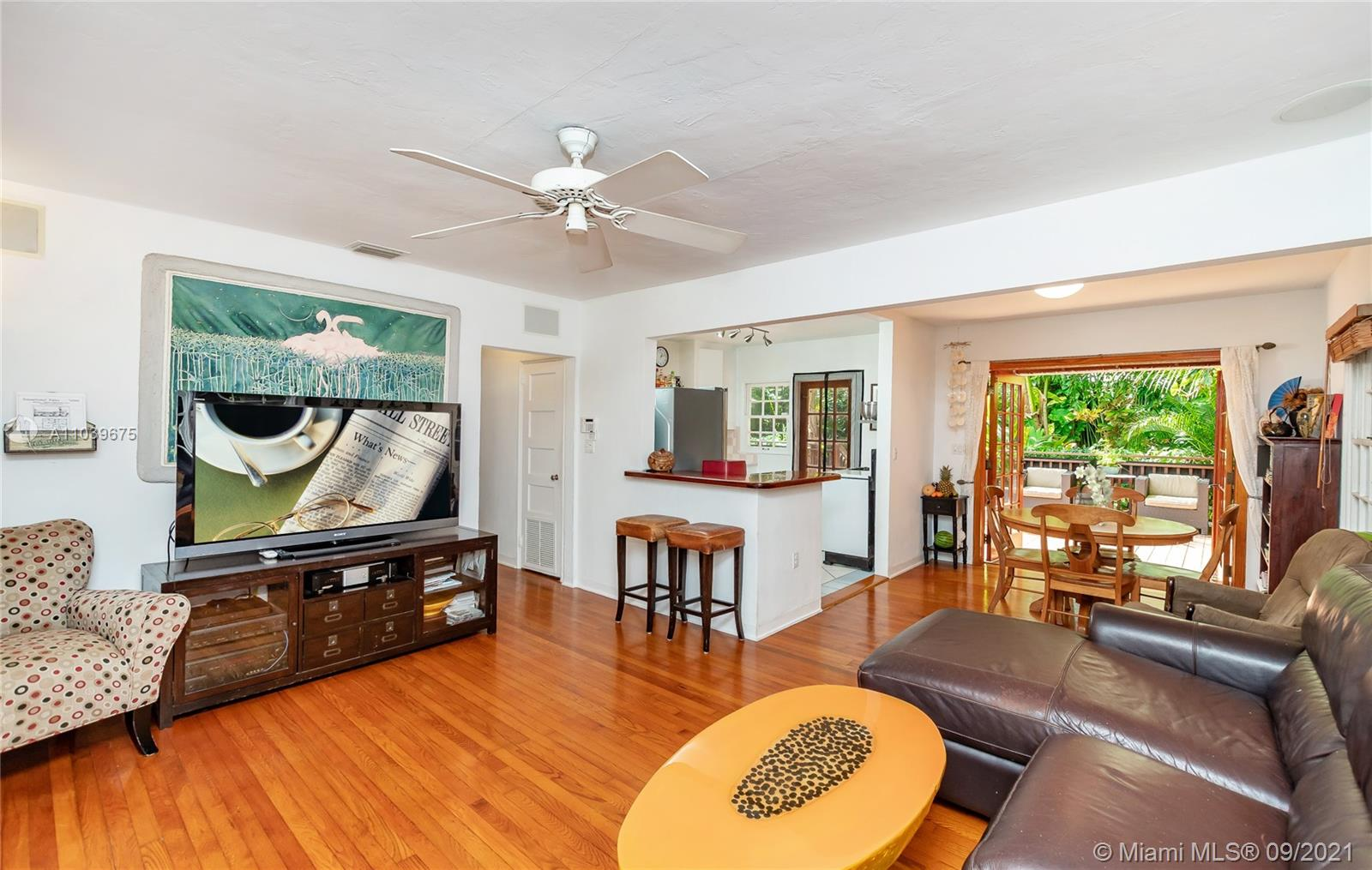 Stop sitting in traffic, enjoy the pedestrian lifestyle in Central Coconut Grove. 87-Walkabilty score. 1-block from Blanche Dog/Kid Park. Terrific investment opportunity T-3 duplex zoned lot. 1280 sq ft. of living area with 1015 sq.ft. of Ipe decking in stunning green gardens. Located 7-min from downtown Miami on a quiet 1-block Street. Tremendous craftsmanship throughout. Original hardwood floors. Turkish stone master bath/steam room. Mosaic keystone patios. Private outdoor shower. Easy to maintain tropical paradise in complete seclusion with bamboo, palms and fruit trees. Metal roof. Automatic gated entry and covered garage. Plenty of parking for guests. Separate storage workshop. Walk to everything-restaurants, grocery, waterfront, cafés, top-rated schools, kayak/boat rentals, Metrorail