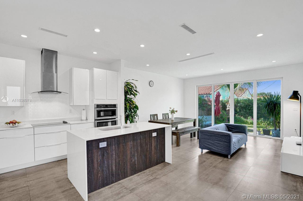 Move-in ready and centrally located modern and impeccable 2-story townhouse built in 2016, offering 3 bedrooms and 2/1 bathrooms. Open modern kitchen with island, quartz countertops and stainless steel appliances. Top-of-the line finishes, high ceilings, all impact windows, smart thermostat with sensors on both floors, smart keyless lock, Ring doorbell and security cameras.  Serene backyard for private enjoyment and entertaining. One-car garage with additional parking spaces.  Minutes from Coconut Grove, Brickell, Downtown, Coral Gables and the upcoming Grove Central Station and The Underline, which provides walkable access to shopping and dining options, as well as the Miami Metrorail and a landscaped pedestrian pathway to the planned Underline park.