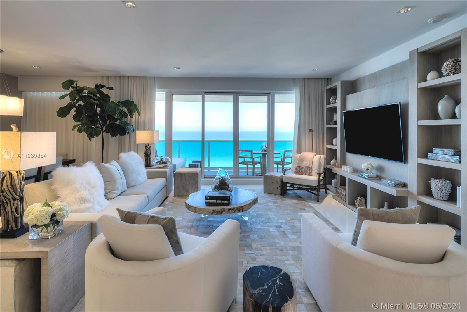A true penthouse at the luxurious 1 Hotel & Homes South Beach.  All rooms are located on the top 17th floor, the highest floor that overlooks all other condos in the building. No one above looking down affording maximum privacy on this penthouses multiple balconies.  All rooms with panoramic direct ocean views through large floor-to-ceiling windows.  Gracious 4 bed/4.5 bath layout with large beautiful master and junior master suites, magnificently furnished by Brazilian designer Debora Aguiar with custom lighting & bathroom enclosures and exquisite Glassos large floor tiles throughout. Experience luxury hotel living with extravagant 5-star white glove services, personal concierge, chauffeured Teslas, 14,000 Sg. Ft. Gym, Bamford Spa, - a truly opulent Miami Beach oasis.