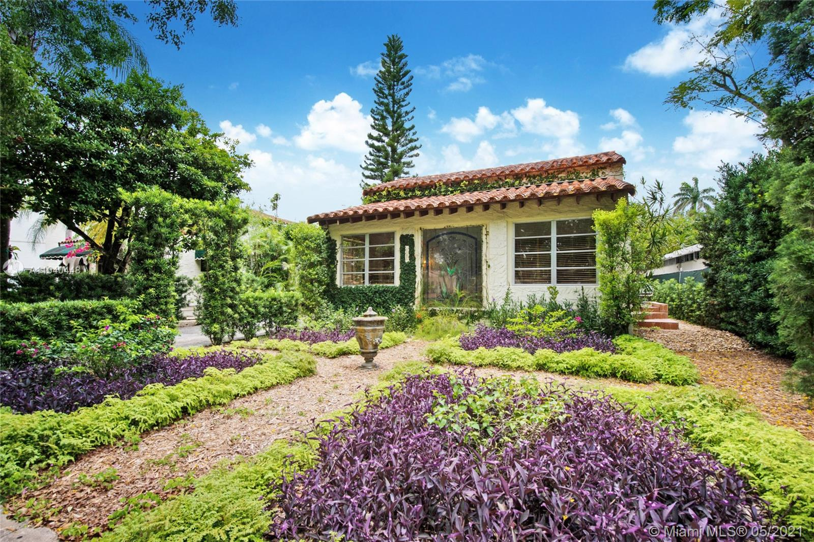 Embrace the charming lifestyle of Coral Gables with this Old Spanish historic designated home. Main house is 3115 sqf and the cottage is 900 sqf for a total of 4015 sqf. Located in the coveted Alhambra Circle Blvd, this two buildings beautiful residence is surrounded by mature oak trees. The main house includes 3 beds/2 baths, original pine flooring, luminous kitchen with antique white cabinets, formal dining room and a spacious living room with historic touches such as a Florida coral stone wood burning fireplace, spanish tile and colorful stained glass window,  two tropical terraces to enjoy the outdoors.  Detached, you'll find a 2 story guest cottage with 2 beds/1 bath, full size living /dining and fenced patio under the shade of trees.  The of living space in a 7,500 sqf lot.