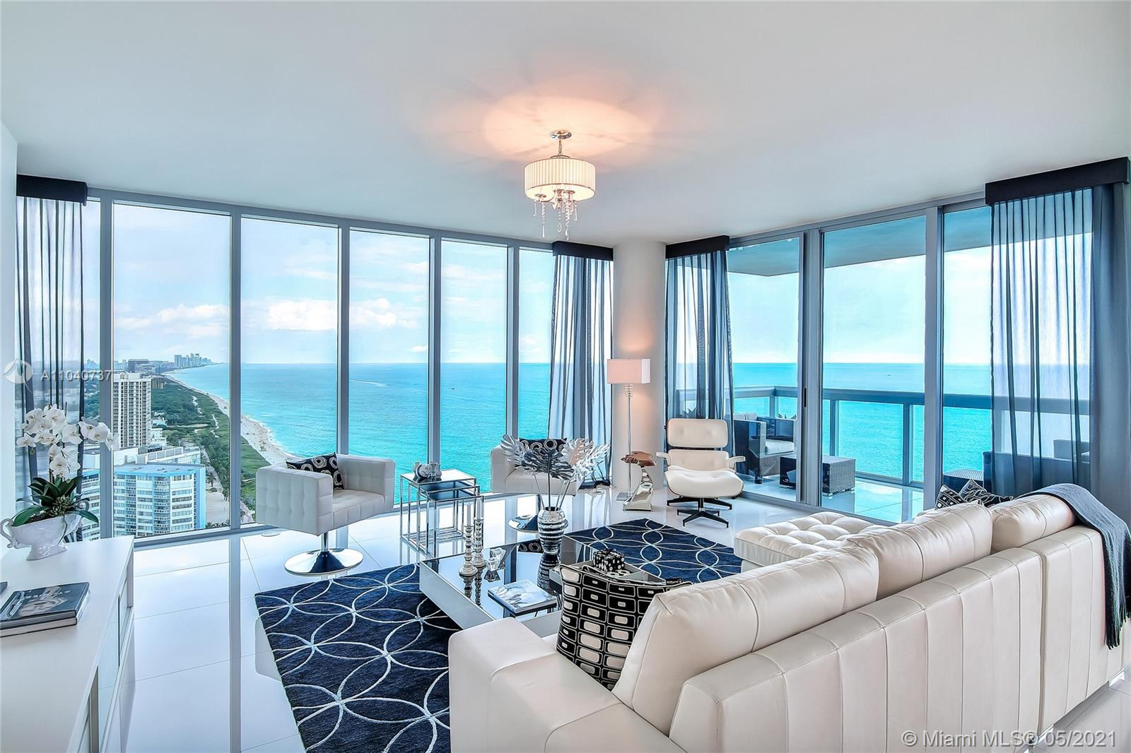 Best views in Miami Beach, see all the way to Ft Lauderdale! Spectacular unit designed by J Britto Designs. 3/3 + Den, floor to ceiling windows with direct ocean & bay/city Views! 2 large balconies, Large open floor plan, Sparkling kitchen with SubZero, Miele &Granite. Located in the Exclusive North Tower of Carillon. 5-Star Service, Valet & Concierge, 8 Memberships to Spa/Beach Club/over 50 Fitness Classes Daily. Organic Restaurants & 4 Pools and private beach attendants.