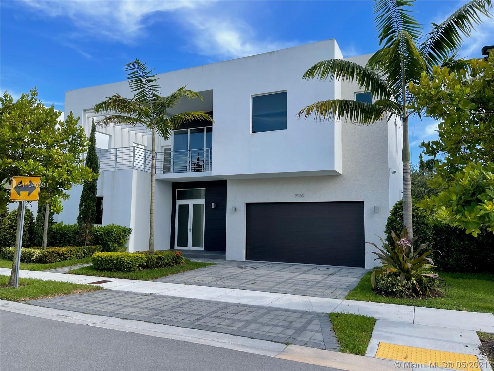 Welcome to Modern Doral 60, the finest and gated community in the city of Doral. Two story home features 5 bedrooms and 5 bathrooms. This house comes with upgrades: A private pool, Pergola, Summer Kitchen. Master bedroom's double walk-in closets installed as well. Exactly done for move-in ready.