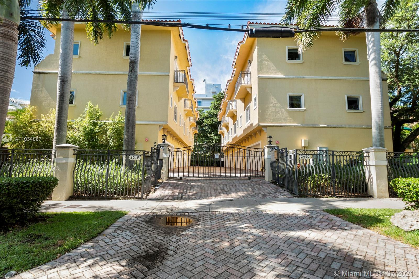 This is a gorgeous, tri-level townhome, just a short walk from Coconut Grove village with incredible restaurants, art galleries and cafes! Pet friendly complex! Incredible location, just a short drive to downtown, Coral Gables and Key Biscayne!  Updated, modern bathrooms & impact glass throughout home. Natural light fills the rooms.  Italian European-style kitchen that features wood cabinetry, quartz countertops & stainless steel appliances. Covered balconies and ground level 2 car-garage with loads of storage with a washer/dryer! Not located in a flood zone. And best of all, low HOA at $320.00 per month.   A must see! ***
