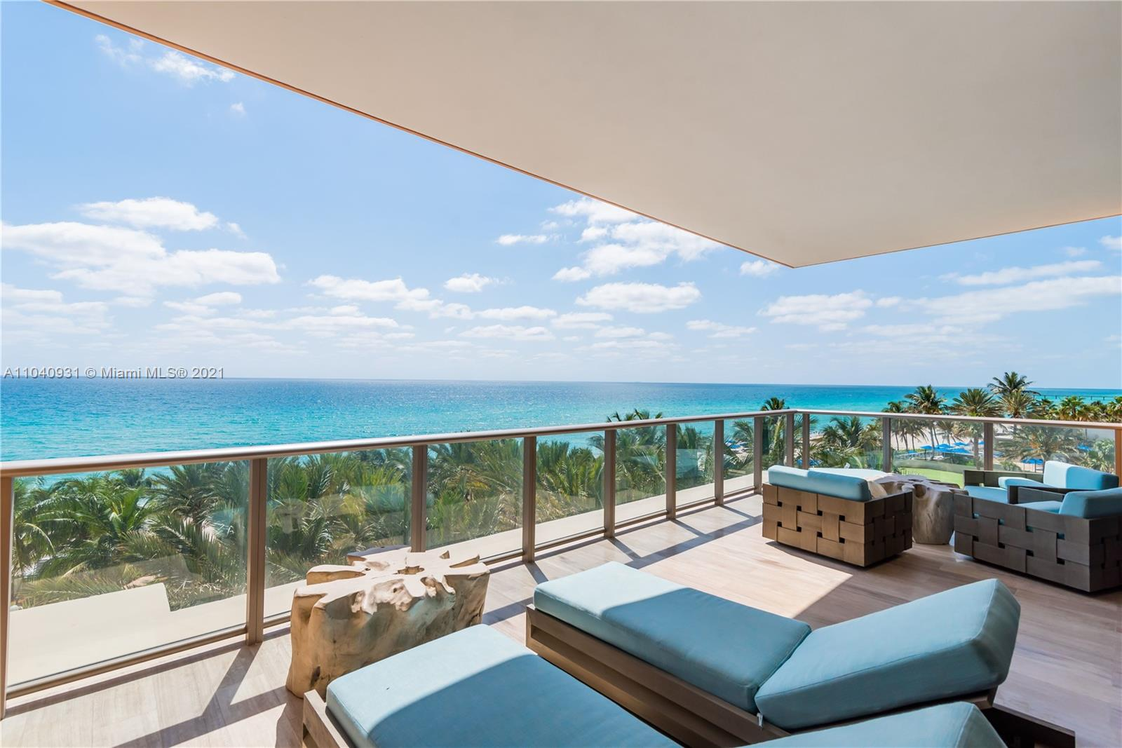 Spectacular oceanfront half floor residence with southern exposure. Feels like a beach house with incredible finishes and upgrades. The residence is in impeccable condition and ready to move in. It features a chef kitchen with Miele appliances, gas fireplace, Master suite with his and her baths, custom  leather closets, Crestron smart home system and 10'6 ceilings and east and west balconies where you can enjoy your own private Jacuzzi. An incredible opportunity to own in the magnificent Mansions at Acqualina and enjoy the five star services at your fingertips!