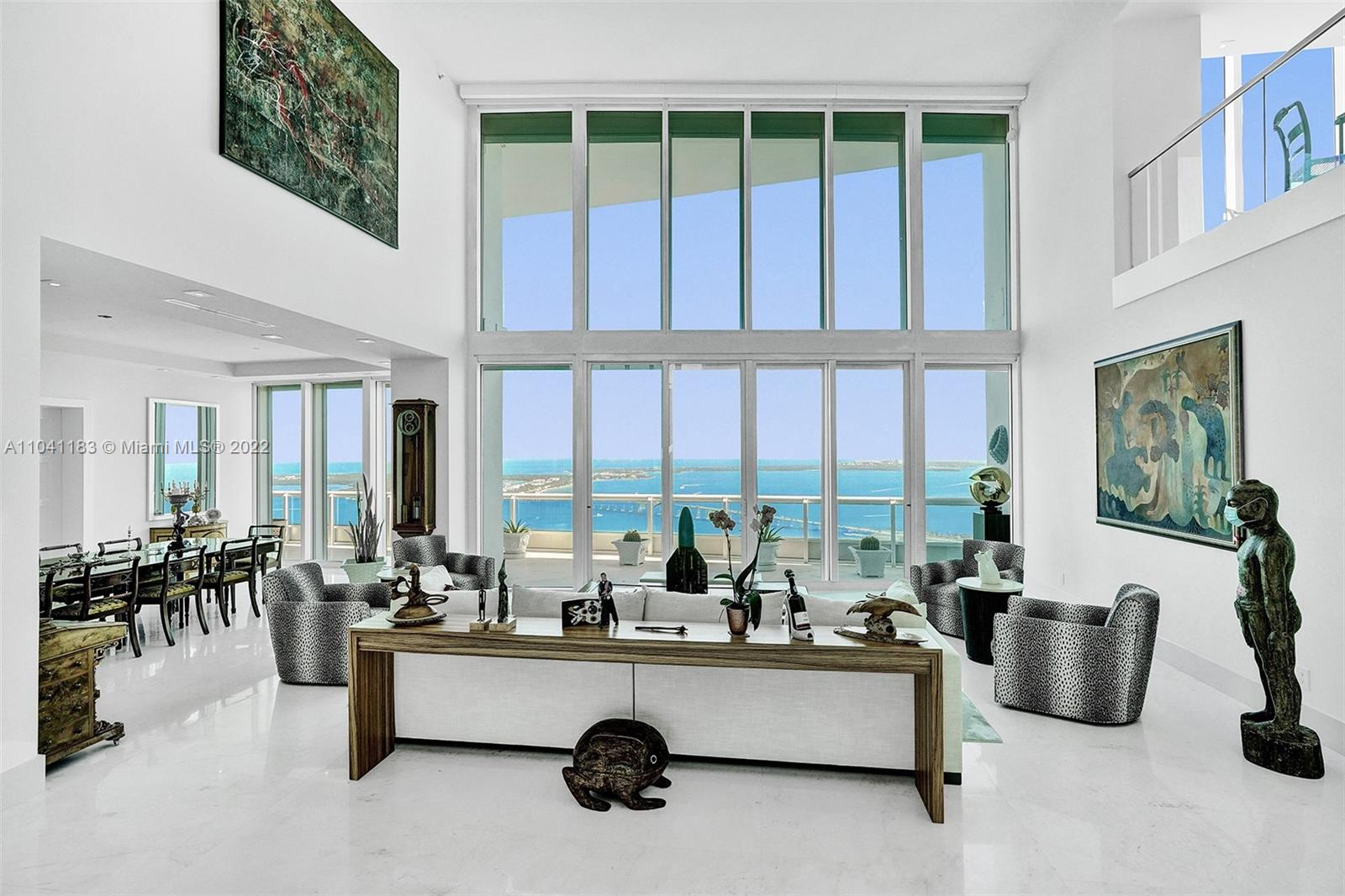 Spectacular views with Miami's sparkling skyline at your feet!  That is the best description of what one sees from this stunning two story, luxury-laden penthouse in one of Miami's top  condominium buildings!  From the two-story, sun drenched living room to the sparkling waters of your private rooftop pool atop the 50th floor of the Santa Maria, no detail has been overlooked to provide luxurious, convenient living at its best. The 2020 kitchen is supported with a full walk- in storage  pantry, as well as an adjacent  butler's pantry and wine room.   Additionally, one will find a spacious entertainment area adjacent to the pool, a large family room, 6 bedrooms 8 baths, a library/office, formal dining room  and private foyer entry. Also included are 4 parking spaces.