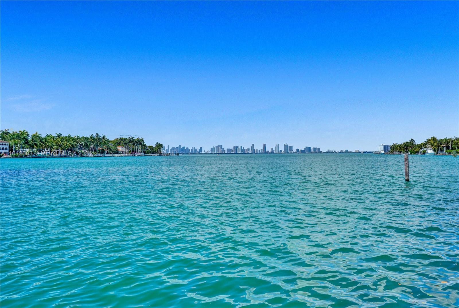 A Boat Lover's Dream House. Amazing Opportunity to own a waterfront home with one of a kind oversized boat dock right in your backyard. Completely updated in prestigious Normandy Isle. Enjoy a fabulous, updated kitchen and brand-new luxurious bathrooms. This spacious two-story 4 Bedroom 4 Bathroom 2812 sq ft home is perfect for entertaining. Sit by the fireplace in your expansive living room with two large double doors leading to the huge covered outdoor patio overlooking the impressive views over Biscayne Bay. Surrounding the home is new luscious landscaping creating your own sanctuary.