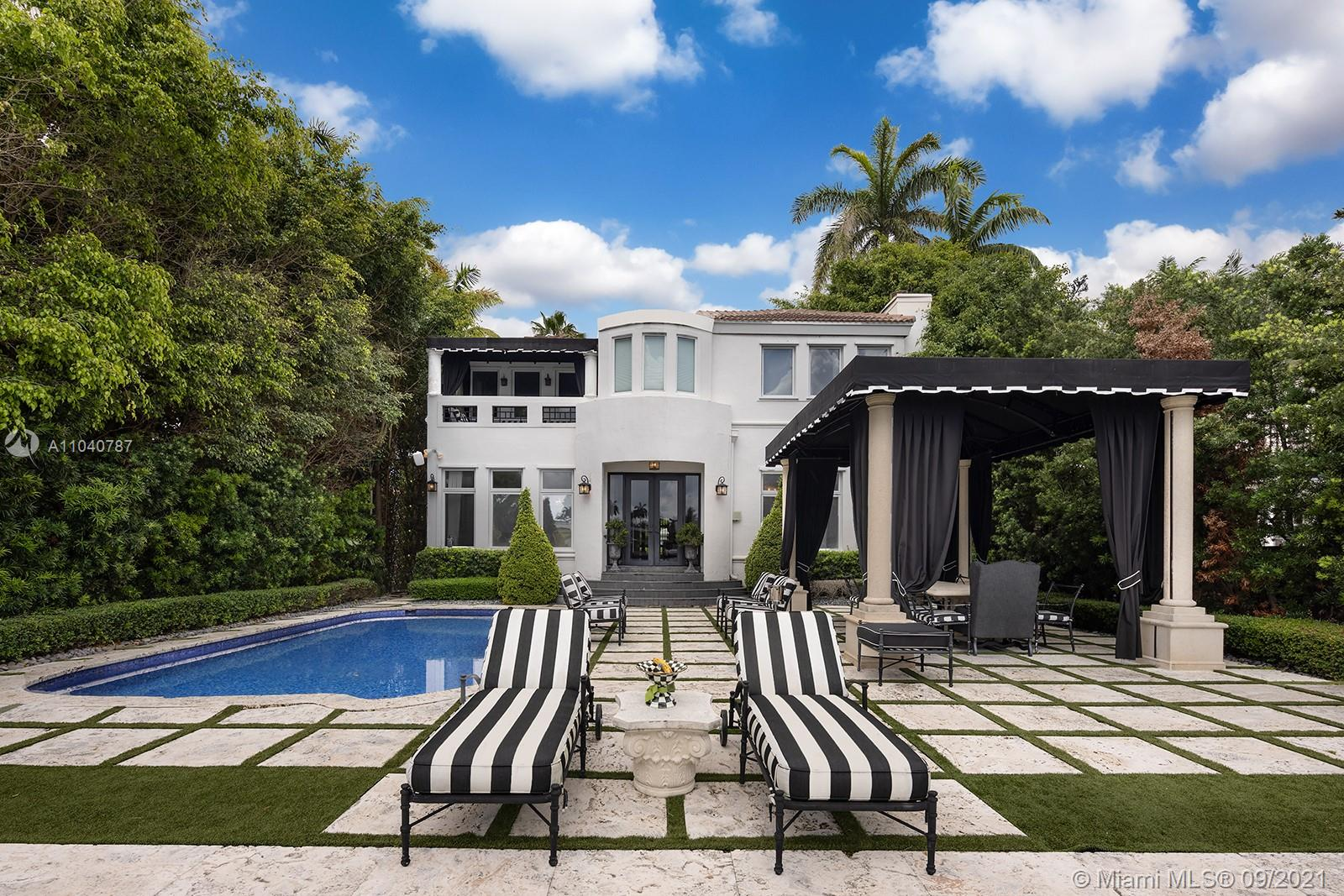 Step Inside With Me! This European inspired waterfront Venetian Islands home was designed by Sam Robbins with architecture by Kobi Karp. 6 Beds, 5.5 Baths complete with black marble & wood flooring throughout, tongue and groove wall paneling, and functional floor plan. Water views from the chef's kitchen complete with Viking 6-burner cooktop, white marble counters, Subzero fridge & custom sliding glass doors that allow for an open or private dining experience. An entertainer's dream with a 14-person dining table, temp-controlled wine wall & a fireplace. Arrive into your elegant brick driveway past oversized privacy hedges and dramatic landscaping. Enjoy the backyard oasis that includes a shimmering mosaic-tiled pool, covered outdoor dining, and wide bay views with breezes off the ocean.
