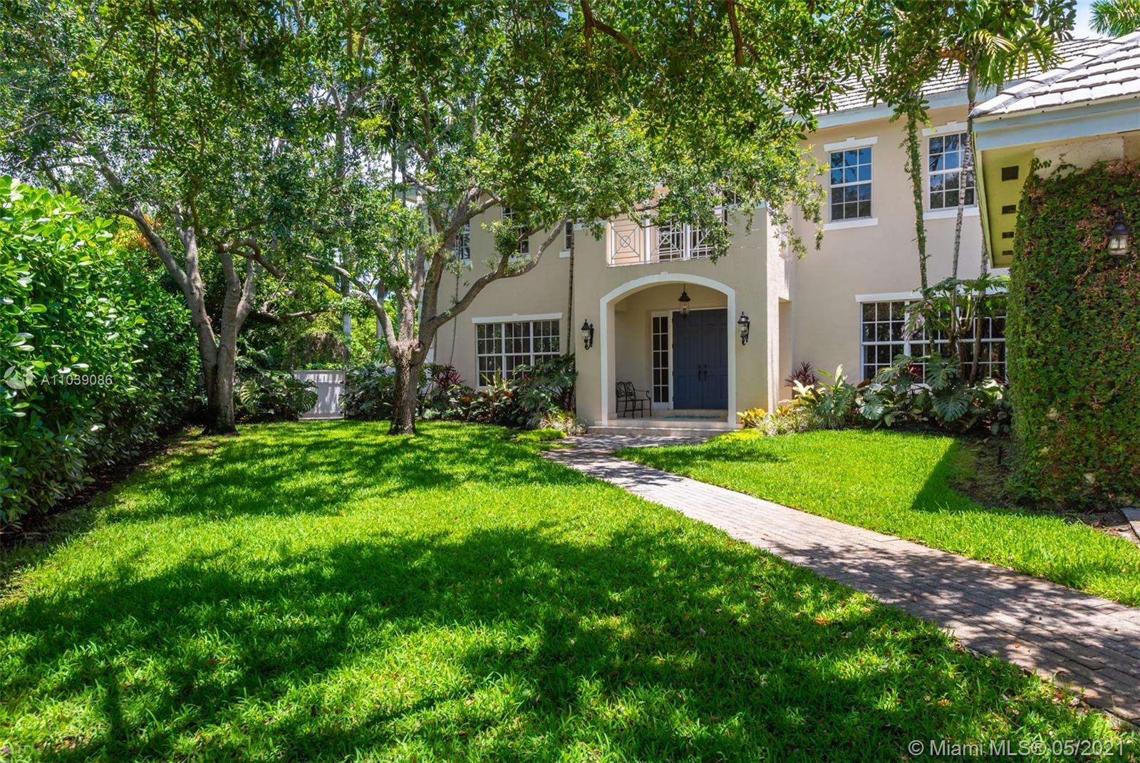 Gorgeously updated 5BR/4.5BA Pinecrest home on .5 acre in the Red Oaks gated community. Each room & bath are unique. Interior designer high end finishes, lighting, millwork & built-ins throughout, marble & wood floors, volume ceilings, impressive staircase, gourmet kitchen, huge closets,luxurious master bth. All impact glass. A true Chef's kitchen w/quartz countertops, spacious island & inviting breakfast rm. Master bdrm w/lg balcony, sitting area, 2 walk-in closets. 2car gar & laundry rm. Spacious landscaped yard, htd swimming pool & wraparound covered terrace perfect for entertaining. A very private setting in gated quiet cul-de-sac of only 5 residences. Well located in desirable NE Pinecrest near the best in Schools, Gardens, Marinas, Restaurants, Tennis, Community Events &  Shopping.