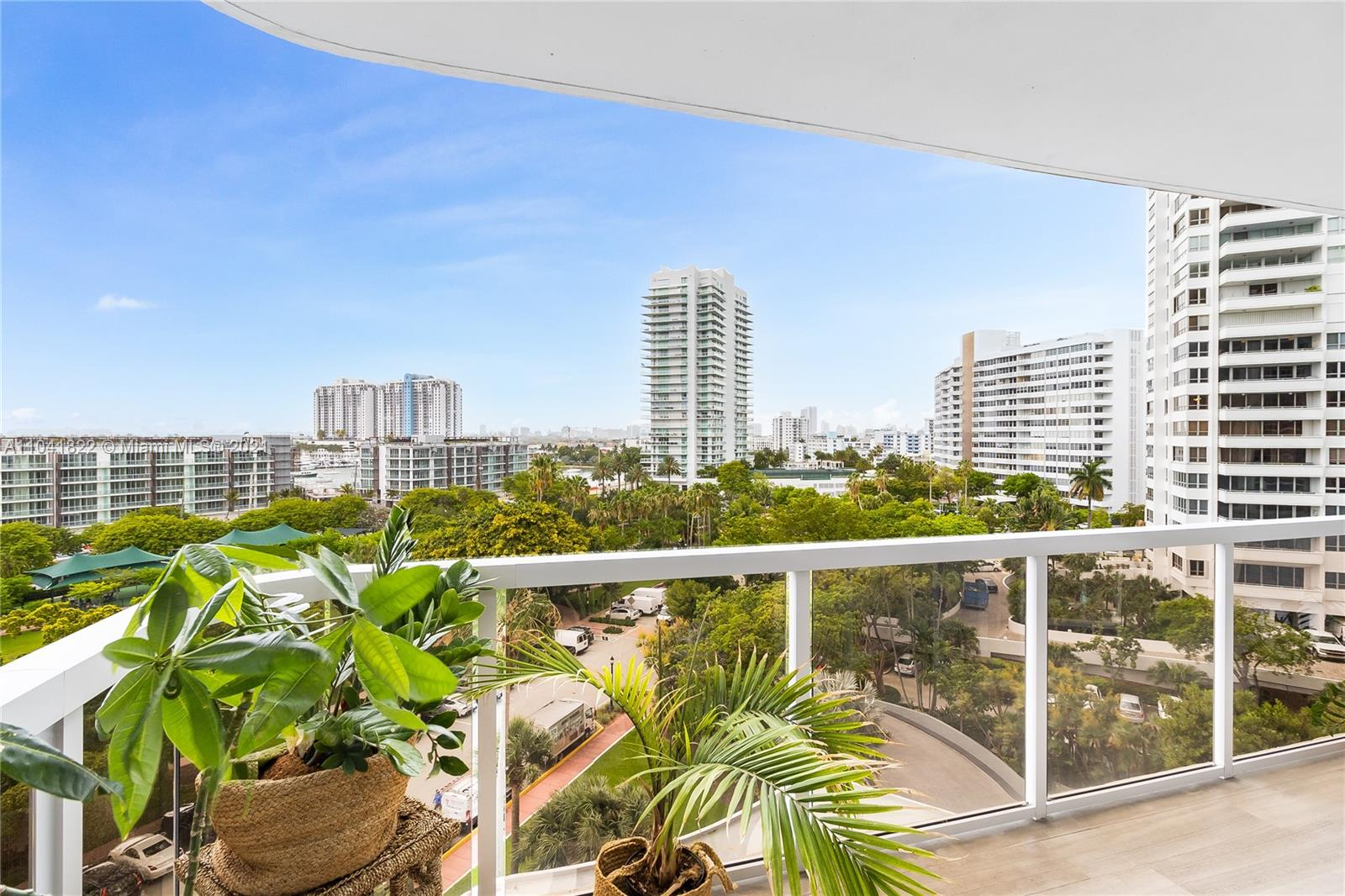 Live on the luxurious Venetian Isles for $648/sq ft! This move in ready 3/3 is the best priced family-sized condo on the waterfront. You deserve space to work from home and entertain - wide rooms , floor to ceiling windows and two 21-foot private terraces extend your living space. Feels like a house with no shared walls! Wide plank oak floors, modern eat-in-kitchen, double door entry, laundry room and 8 generous closets will keep you organized. Lobby, hallways and amenities have been updated with a captivating resort vibe. Established and secure condo w/ Bayfront pool, marina, outdoor grills, hot tubs, health club, tennis courts, resident lounge and on-site management. 2 garage spaces + storage. 40 year recertification well under way.