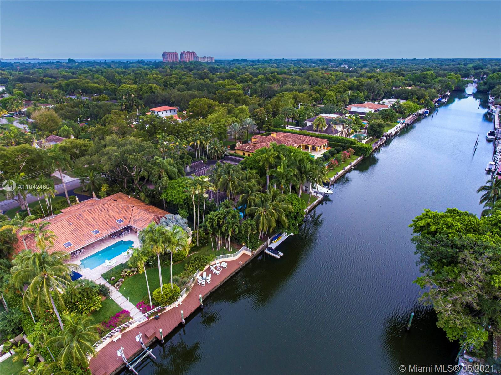 Spectacular WATERFRONT home with an address to match, on the most sought after Riviera Drive, Coral Gables waterway, East of US-1. 5-bedrooms, 4Baths, this well maintained home has a large pool, covered patio, impact windows and doors, summer kitchen large living areas, hot tub off the master suite. It is walled in, has circular driveway and two car garage. The property is beautifully landscaped, and has a large dock and boat lift on the widest section of the waterway. homes like this, rarely come on the market, as those who buy on the Riviera waterway usually stay for decades as is the case with this home. The Coral Gables waterway has two 18 ft + bridges to the bay and is one of the best hurricane harbors in South Florida. This is a unique opportunity.