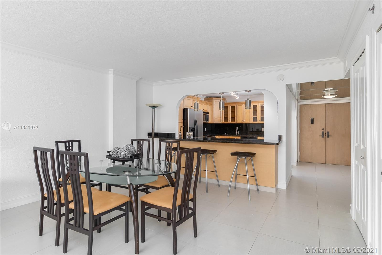 SPACIOUS UNIT IN DESIRABLE SURFSIDE WITH  LARGE BALCONY IN A  OCEANFRONT BOUTIQUE BUILDING. CTN IS IDEALLY LOCATED WALKING DISTANCE TO THE RENOWNED BAL HARBOUR SHOPS.  BUILDING HAS 24 HRS SECURITY, IS 1200 SQ FT.UNIT IS 1 BEDROOM  WITH 2 BATHS WAS CONVERTED INTO A 2 BEDROOM, 2 BATHS  . UNIT IS REMODELED  WITH OPEN KITCHEN , STAINLESS STEEL APPLIANCES, MODERN FIXTURES & PORCELAIN FLOORS.  HEATED POOL, FITNESS CENTER, BARBECUE AREA ,SAUNA  & PARTY ROOM. PARKING #48