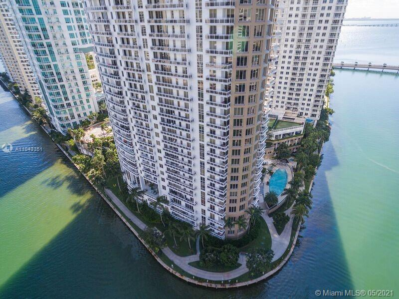 ONLY unit with 13 feet ceiling high, newly renovated, with amazing view of Miami River entrance. 2 parking garage, in the very best building in Brickell Key.  Showings starts on Wednesday 5/19.. Mondays-Wednesdays-Fridays 11am-12 pm & Saturdays 12-2 pm all with appointment only with at least 12 hours notice. This is the best unit in the entire Key..