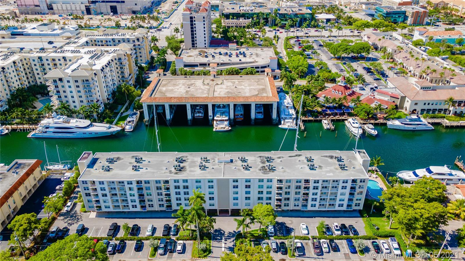 Welcome to your new waterfront paradise! This unit was remodeled head to toe - just bring your toothbrush and your bathing suit. Located on the intracoastal with large porcelain tile, open concept living with modern white cabinets, quartz countertops, custom stainless steel appliances, impact windows, & washer/dryer in unit. Building is gated and has its own dog park, pool, gym, sauna and you can BBQ while watching the gorgeous yachts pass by. Walk to several waterfront restaurants and shops. 2 miles from the beach. Can rent after 1 year. ONE OF THE FEW CONDOS YOU CAN BUY WITH 5% DOWN!!!