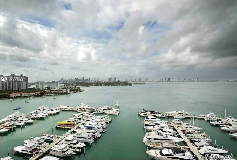 A unique opportunity, the only unit 3/2/1 with water views (Amazing open & direct wide bay views of downtown, cruise ships and sunset) in the prestige 1900 harbour building, located in the most amazing neighborhood of Miami beach, Sunset Harbour. This is a Full service bldg with 2 pools, marina and a renovated gym. Next to all the S. Beach action, Lincoln Rd. Walk to Publix, Fresh Market, restaurants, movies. This luxury apartment comes with Marble & cherry hardwood flooring, granite and stainless steel kitchen, European built-in closets. 1 parking plus 1 valet parking and storage.