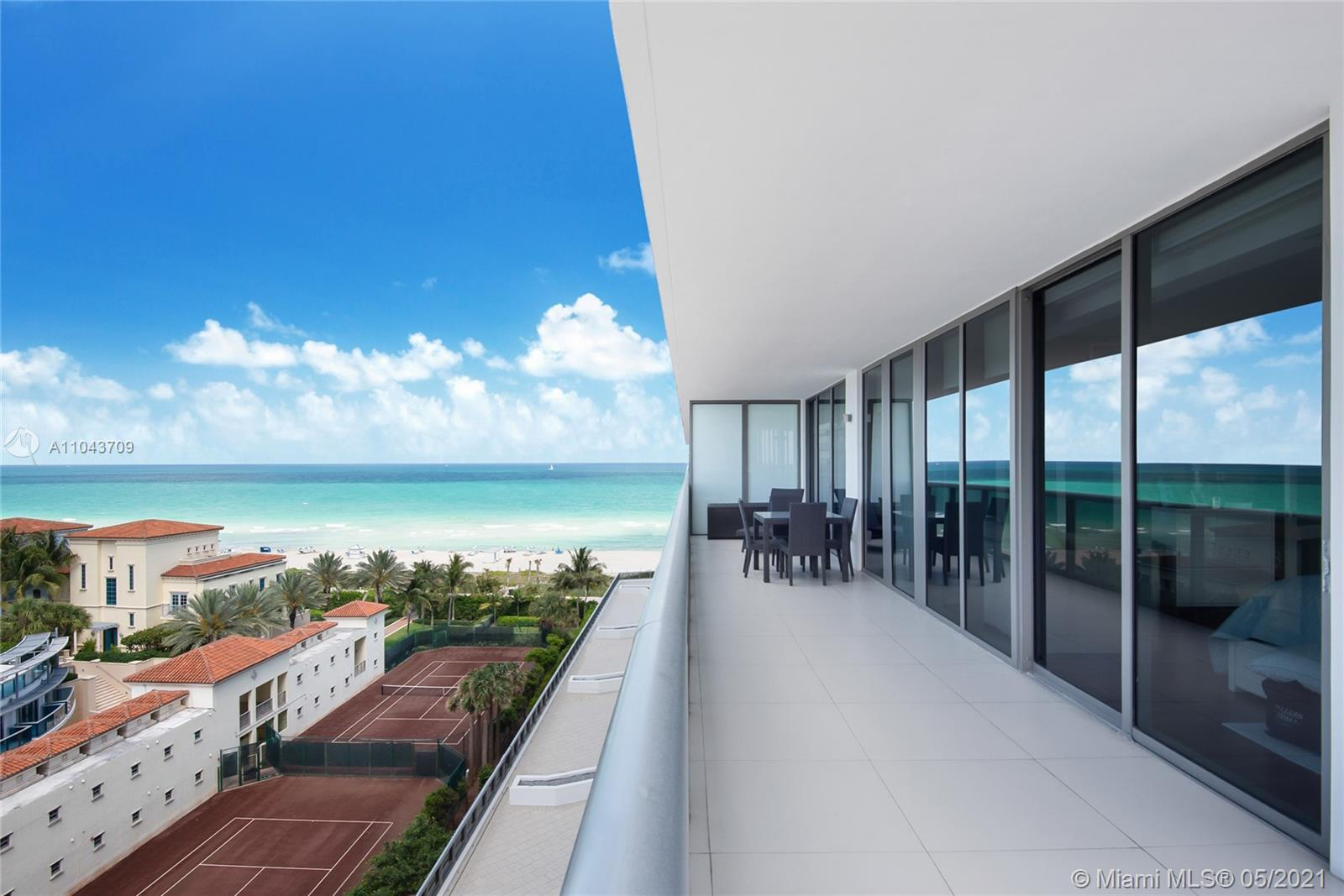 Spectacular corner unit, 2 bed 2.5 bath with amazing ocean and city views and a wraparound balcony ready to entertain. Unit has many upgrades including, custom made doors, enlarge kitchen island with quartz counter top, remote control blinds,Italian porcelain & wood floors, extra lighting, and built-in closets. Impeccably maintained and with an incredible floor plan this unit has it all. Perfect location in the exclusive MEI condo with 24 hour valet, beach access & service, sea level pool, state of the art gym and concierge services.