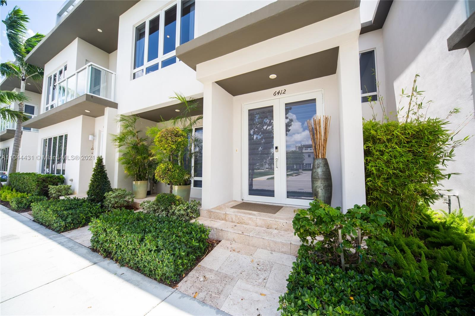 """PLEASE READ --- NEXT-GEN property. Biggest LOT in the condo. Beautiful home in the best community of Doral - """"Landmark"""". Main house with 3 spacious bedrooms & 3 modern bathrooms. External efficiency with independent entrance with 1-bedroom area + bathroom + kitchenette + washer/Dryer combo. High end appliances and quartz countertops in kitchen and baths. House is rented on a month to month for $3,000 and efficiency for $1,400. Plenty of upside to rent the house for up to $3,900 just the main house plus next-gen income. Great income producing property. Lowest HOA in the area - only $265. Send offer before looking at the house. Owner ready to sell."""