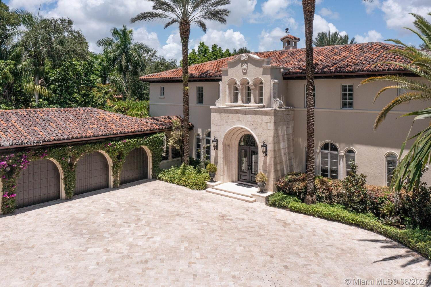 Elegant estate in the neighborhood of sought-after Ponce Davis. This custom gated 12,565 sq. ft. home's layout is best for entertaining. Main house has 5 en suite bedrooms & 2 half baths, a gym + library/office + wine tasting room & 1,100 bottle wine storage room + billiards room + family room & more.  A 1/1 guest house with a kitchen and ample living area completes this gem.  A state-of-the-art kitchen offers a professional Viking gas range + Miele coffee maker + Sub-Zero fridge & more.  The summer kitchen has a chef's gas range, sinks, bar plus an adjacent massage room.  Additional details: a state-of-the-art sound system, full house generator, professionally landscaped hidden gardens and fountains, as well as a 4-car garage. This residence has all you need for an extended time at home!