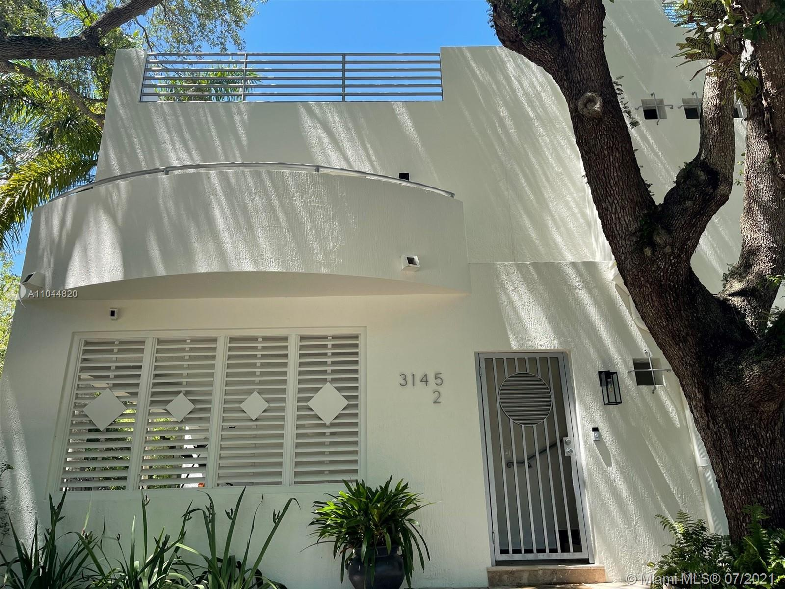 Welcome home to the best the Grove has to offer. This is the upstairs condo of a two unit condo building but it looks and feels like a single family home. This second floor smart home is nestled in the trees with a beautiful view down Gifford Lane. The well-appointed 2 bed/2 bath offers an updated kitchen with Subzero/Viking/Thermador appliances and brand new full size smart washer/dryer. The master comes with a spacious in-suite bath with double vanity, spa tub and built-in walk-in closet. Two gated parking spaces and Ring security provides peace and serenity in Miami's most sought after family friendly neighborhood. Enjoy the Grove lifestyle. Walk to dinner, shops and Miami's best schools.