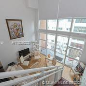 NY Loft Style with skyline views. The unit has soaring ceilings, 1/2 bath downstairs, W/D in unit. Prestigious VIZCAYNE building. best location in Downtown in front of Bay Park, 2 Metro-Mover Stations, Bayside Mall, AA Arena, Parks and Museums. Steps from Brickell & Entertainment. Vizcayne has the largest 5-stars amenities and pool deck in the area, hot tub, business center & theater.
