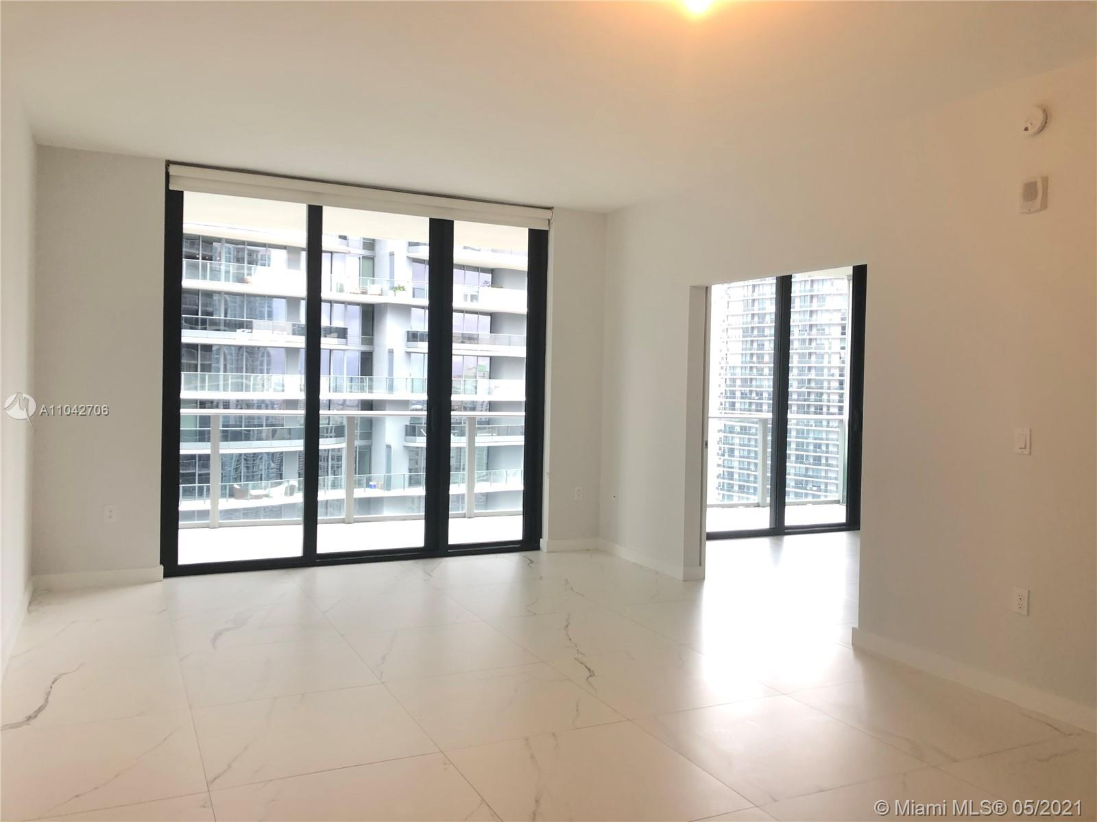 An exciting urban lifestyle awaits at 1010 Brickell! Spacious and bright 1 bed/1 bath unit on the 41st floor with marble-like tile floors throughout. No Carpets! Impact Floor-to-ceiling glass throughout providing plenty of natural light. Large balcony along the entire width of the unit with access from the living room and bedroom. European style open kitchen with the best appliances and ample storage. Two Built-out closets. Washer/Dryer in unit. 1010 Brickell offers: 24/7 security, indoor and rooftop pool, gym, spa, children's play area, valet parking and much more! Walk to all the best in Brickell. Sorry no pets. Immaculate unit and available now for immediate occupancy!