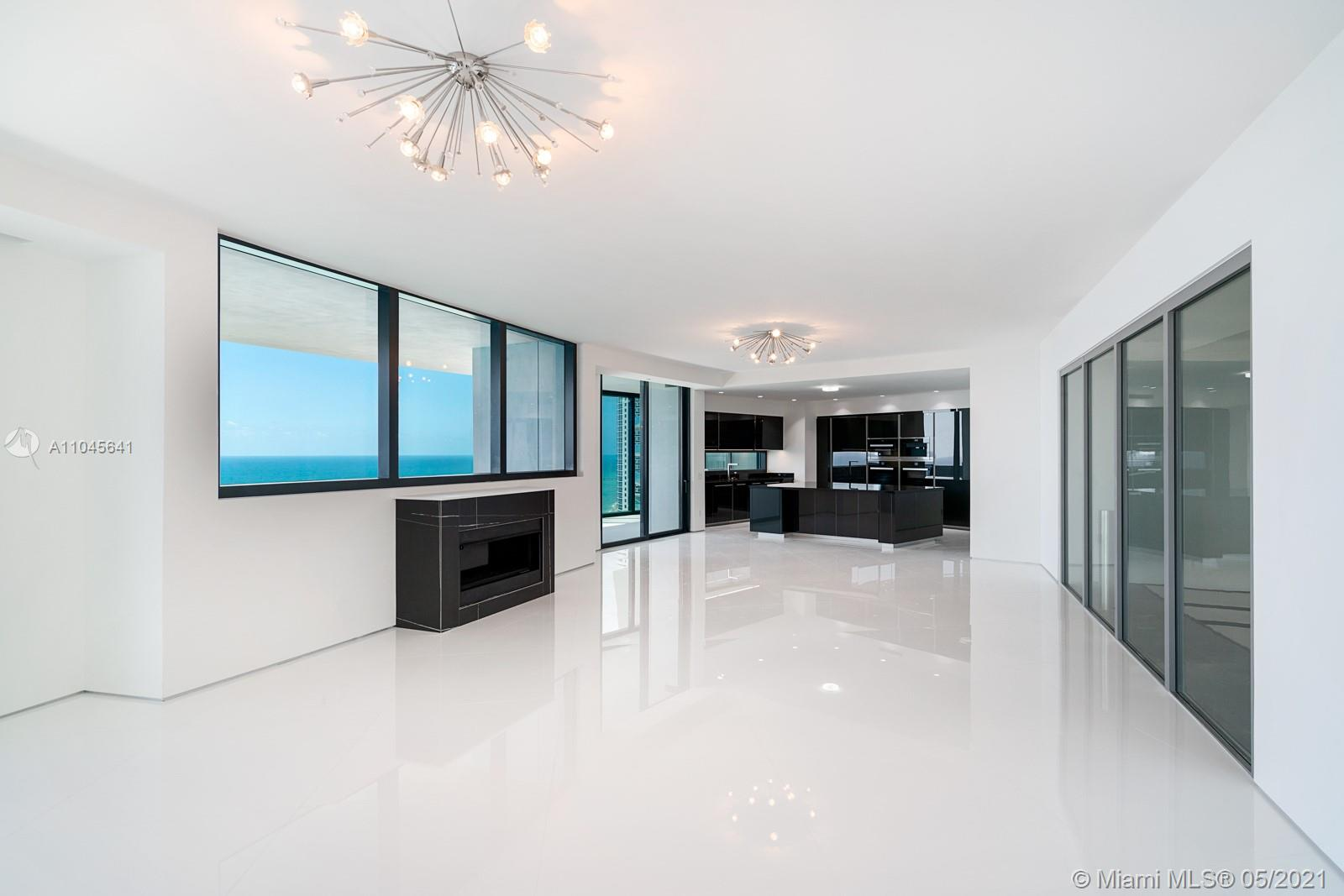 DRIVE YOUR CAR RIGHT INTO YOUR LIVING ROOM! This BRAND NEWLY FINISHED 3 bedroom apartment at Porsche Design Tower features a 2 car garage in the living room and a heated salt water pool/jacuzzi on the balcony. Enjoy living in the only building you can drive into your apartment with your car. Residence includes Miele appliances, private elevator, private restaurant with in room dining, building concierge, car concierge, full beach service, two pools, spa, car simulator, sports simulator, movie theatre, salon, and party room. Enjoy five star resort like living in one of the most exclusive building in the world!
