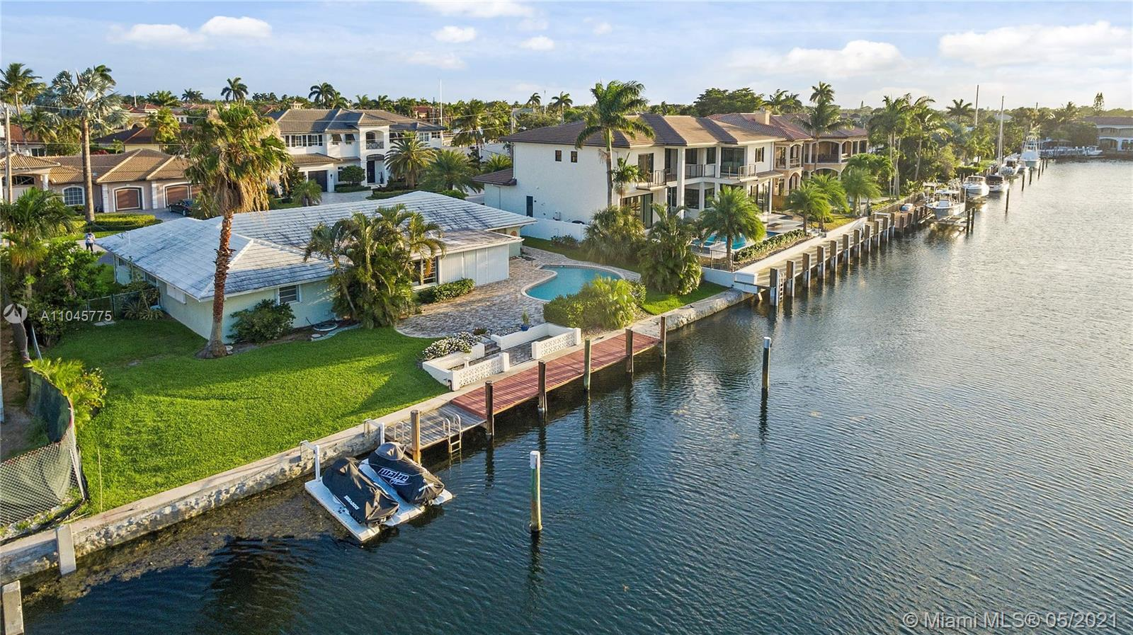 South Exposure on island street in Lighthouse Point on a wide canal just minutes to the Hillsboro Inlet. Fantastic opportunity to build new on a premier lot.