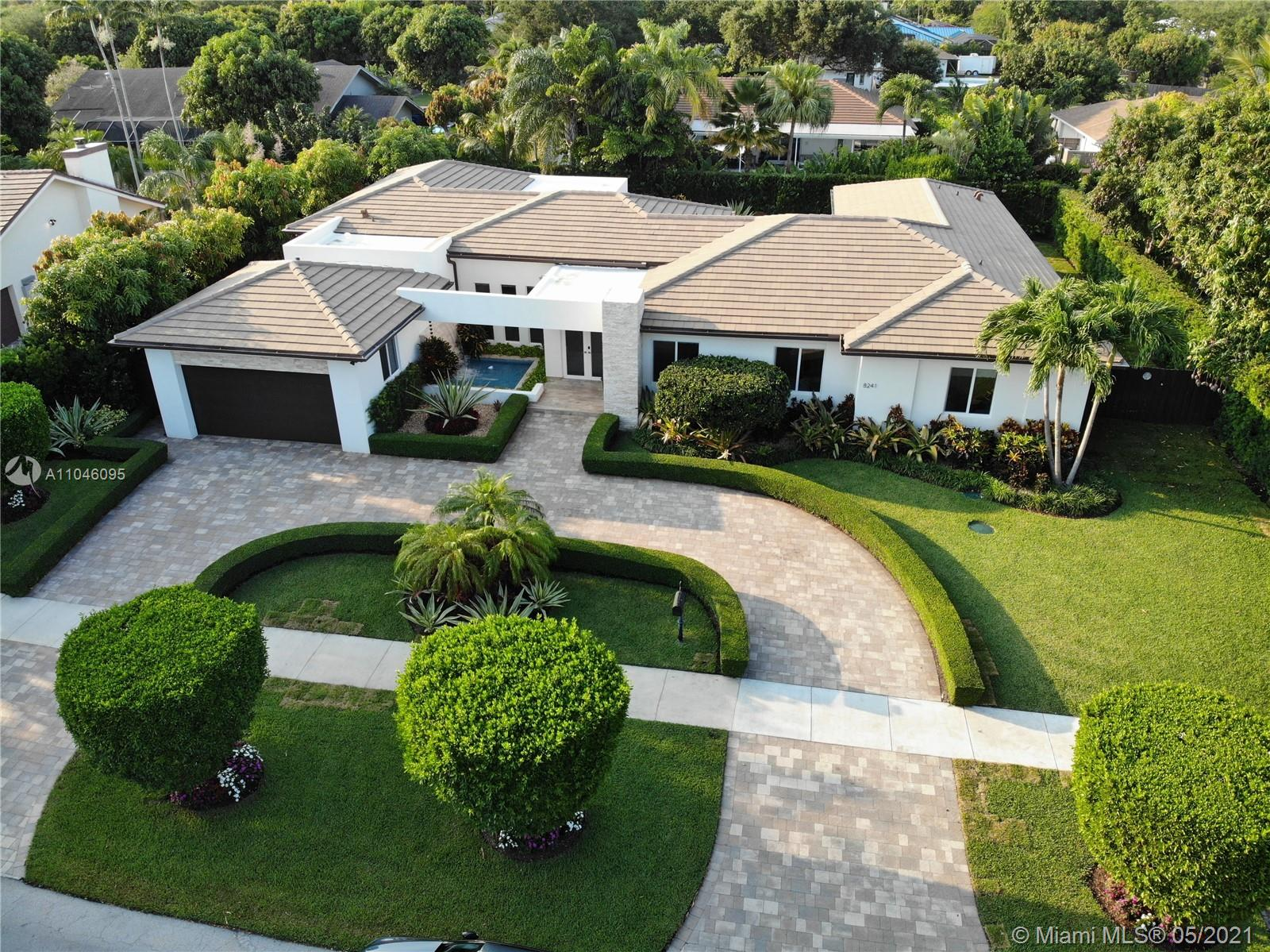 """A masterpiece one-story contemporary luxury mansion in Palmetto Bay. Designed for modern living. This 4,184 SF home features an open-concept floor plan w/12 FT/10FT high ceilings, seamless indoor/outdoor living spaces, chef's kitchen w/ oversized island & top of the line electric/gas/steam Thermador appliances. 120 gallons propane tank to feed the high-end dual fuel Thermador range and the LG dryer. The house is fully wired for the best internet connection.  Situated on a fully isolated lot with only one-story homes all around. This 4 bed + 1 bed/office, 3.5 bath retreat has so much to offer: manicured landscaping with Podocarpus trees all around for best appearance and privacy, pool w/ salt-chlorine system, oversized 2-car garage, shades & 32"""" X32"""" porcelain tiles... continued below!"""