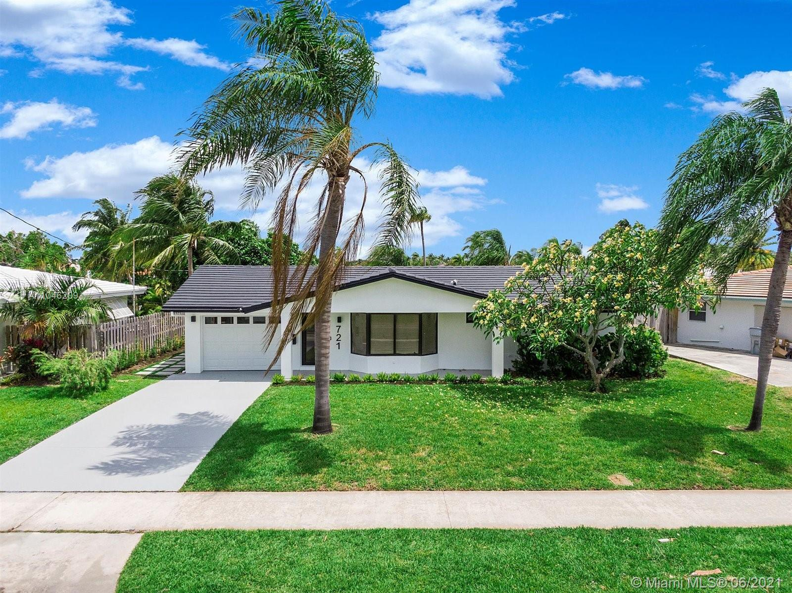 Beautifully renovated, modernized canal front house with stunning views! This boaters paradise, gorgeous home rests at the end of a canal with approximately 40' concrete seawall with easy ocean access! 3 full baths and 2 of the 3 bedrooms are masters with canal views and backyard access. Room for pool in backyard! This complete smart home features in-Ceiling Home Theater Speaker System, Nest thermostat, Ring video doorbell & LED lighting throughout. All new impact resistant doors, windows & garage door is installed. Stay cool & comfortable with air conditioned, smart garage including a new washer & dryer. The kitchen is fully upgraded with brand new appliances, cabinets & granite counter tops. Great location in a very desirable neighborhood.