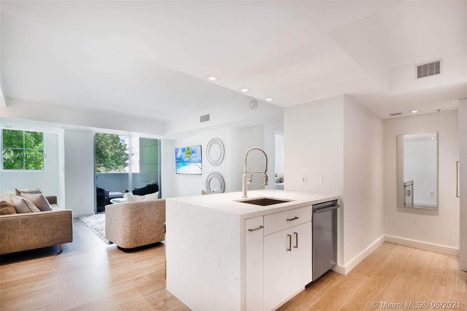 Located in coveted South of Fifth neighborhood, this unique townhome-style fully remodeled residence boasts an open kitchen with Bosch appliances and quartz countertops, custom blinds and tile flooring. Featuring direct entrance from the street, as well as an interior entrance, this home is ideal for surfers and dog owners. This beautiful unit also comes with two large storage rooms, and can be delivered fully furnished for an additional cost. The Cosmopolitan is a full service building with 24/7 security, heated pool with Jacuzzi, fitness center, & club-room. Walk 2 blocks to the beach, fine dining, & South Pointe Park. Building is financially secure.