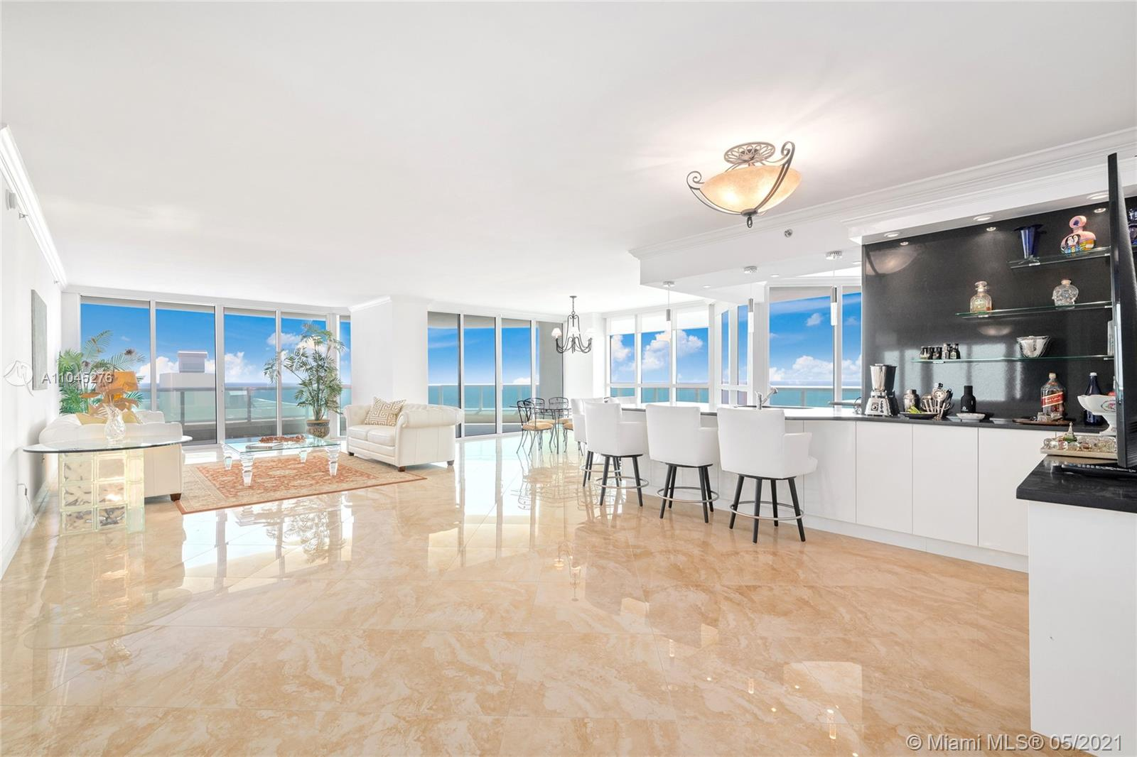Located in one of the most luxurious oceanfront buildings in Fort Lauderdale, this 2,950 sqft condo in the Las Olas Beach Club defines coastal sophistication. Rise into this 3-bedroom + den, 4-bathroom corner unit via private elevator, and move through the open layout space showcasing direct east and southeast views. Watch sunrise and sunset from the wrap-around terrace with direct ocean, intracoastal and skyline views. Every bedroom also has a water view, with its own full bathroom and walk-in closet. The master bedroom has two walk-in closets and a master bath with a full bathtub, double sinks and a walk in shower. The kitchen has Miele and Subzero appliances. Building amenities include three hot tubs, infinity pool, spa, full gym and much more!