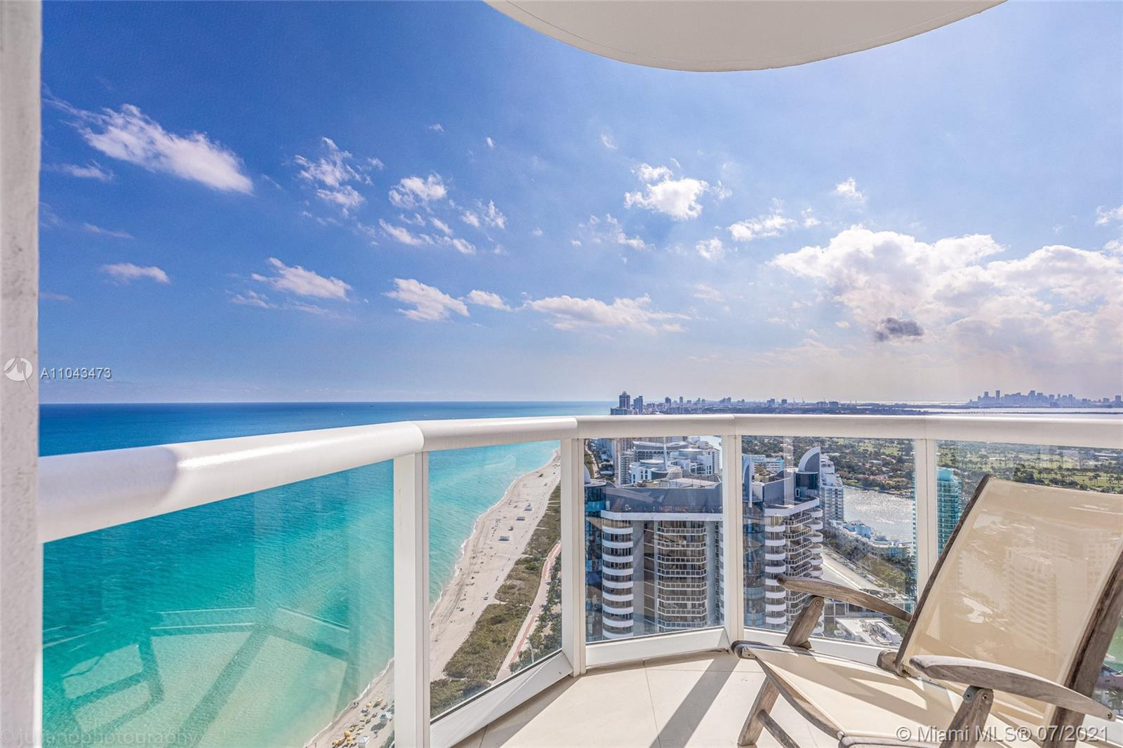 Breathtaking unobstructed views from the 42nd floor!!! Floor to ceiling sliding glass doors and windows in every room for easy access to the balcony and to enjoy views of the downtown skyline, Biscayne Bay, and the Atlantic ocean. Beachfront condo with direct access to the beach. Immaculate marble flooring all throughout. The kitchen is equipped with top-of-the-line stainless steel appliances and the master bath features a jacuzzi with separate shower and double vanity. Building amenities include a gym, sauna, steam room, heated pool, tennis court, beach service, attended lobby, 24-hour valet parking, and much more! A Must see!