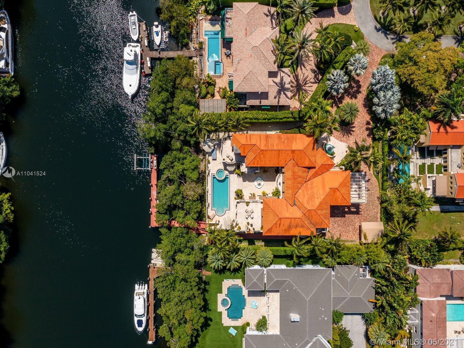 Enjoy exceptional WATERFRONT lifestyle,in this Classic Mediterranean 9,210 SF Actual Area COCOPLUM ESTATE. Ideally located on a private cul-de-sac in one of Coral Gables most coveted gated communities,this 7 bed,8.5 bath home is a boaters dream feat. 120 Ft of water-frontage w/NO BRIDGES TO BAY in an oversized 22,725 SF Lot.Built for entertaining this home feat.formal dinning&living,large kitchen,expansive family room w/full bar&movie room+center courtyard leading up to the pool&summer kitchen.Featuring the ideal floorplan w/large master suite+3 additional beds all w/ensuite baths&walk in closets upstairs,on the 1st floor you can find 2 home offices w/full baths+ a staff room.3 car garage,elevator,dock w/boat lift.Cocoplum offers 24/7 security,clubhouse,tennis courts,marina.