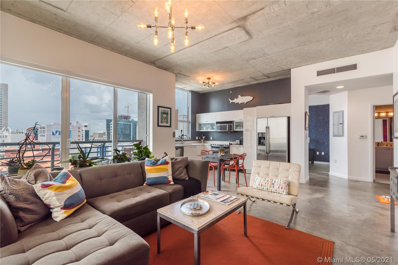 Bright west facing loft, 2 full baths, concrete floors and ceilings, lots of storage/closet space, in-unit washer/dryer, hurricane impact windows and a balcony. The 2nd bedroom is opened to the living room, currently used as a home office, but can be converted to an enclosed bedroom. The building features full time security and maintenance, doorman, roof top pool and spa, top floor gym with great views, and a 2nd pool on ground floor. Great downtown location, right next to the metro mover station. 1 parking space is guaranteed in the parking garage across the street at $60/month paid directly to Miami Parking Authority. For this unit, 2 Pets are allowed up to 30lbs each. Pictures were taking with previous tenant's furniture.
