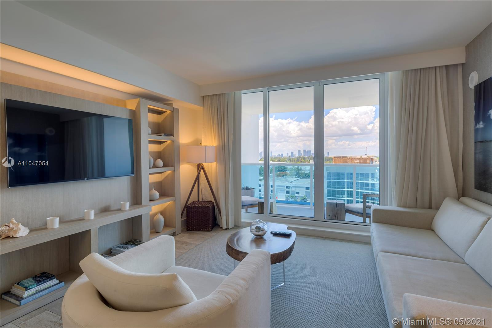 Gorgeous 2 bedroom skyline view 1,305 SF. luxury condo rents between 30% - 60% below the hotels listed rates. This condo is available for short term as well as yearly leases.  Luxurious linens and towels, Gilchrist & Soames toiletries, daily coffee and tea. Residence comes with a fully furnished private balcony with views of the Miami skyline. Custom Italian and Brazilian furniture package provided by the hotel. Plush living room sofa that converts into a queen bed, ItalKraft kitchen with stainless Bosch and Sub Zero appliances, as well as a four seater dining table. Our guests have access to all of the hotel amenities including 4 swimming pools, 4 restaurants, beach service, cabanas, fitness center, spa, valet service, concierge, ballroom, conference rooms and more.