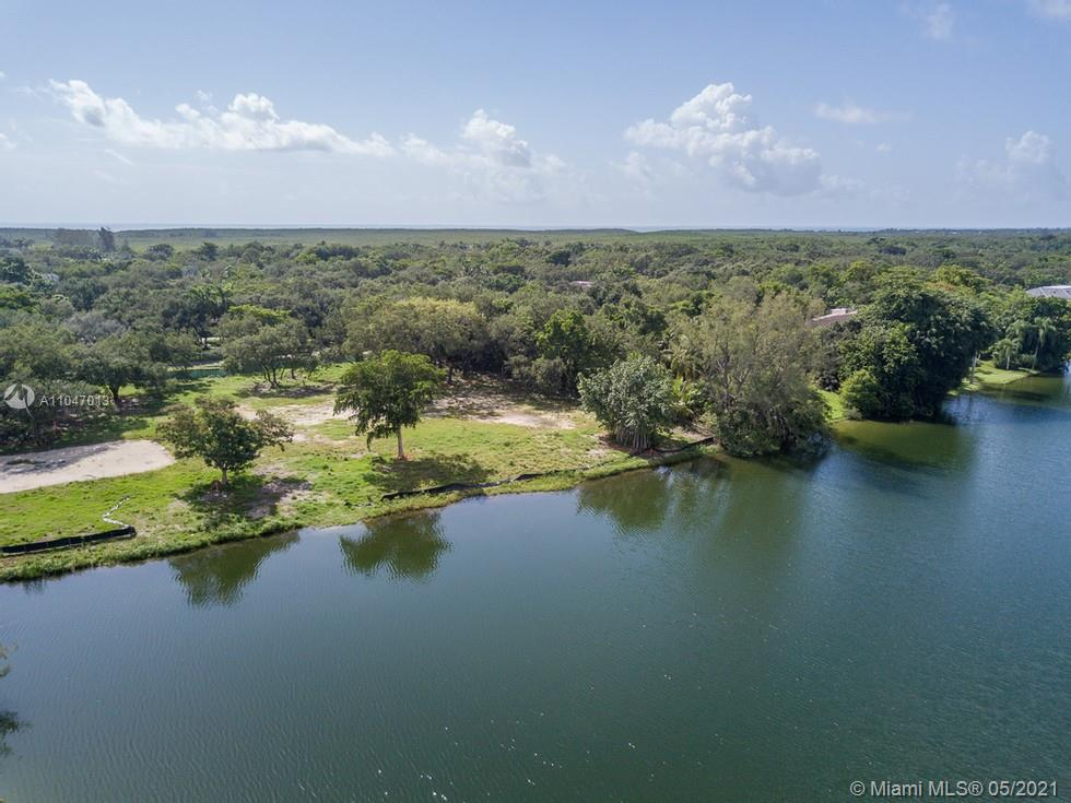 Build your compound on this 62,726 SF wide water lot in Snapper Creek Lakes. Property is cleared and ready to break ground. 24 hour manned guard house and roving patrol. Walking distance to marina with bay access. Dozens of mature oak trees throughout. Membership into Snapper Creek Lakes Club is a prerequisite to purchase. Owner/Agent.