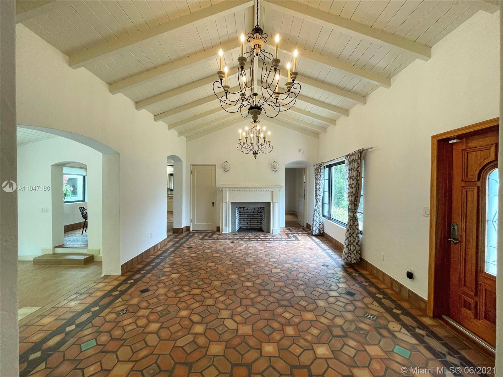 Beautiful 1930's Spanish/Art Deco 3BD/2.5BA, designed by renowned architect Robert Fitch Smith, on large, lush 10,000 sf lot. Lovingly remodeled for modern living, while preserving its many charming details: dramatic cathedral ceilings; original mosaic tile floors; fireplace; living, family & dining rooms; bonus maid's room or office; laundry; garage. Open kitchen has gorgeous Brazilian granite counters, SS appliances & built-in wine cooler. A backyard pavilion, festooned with speakers & festive lights, has an outdoor kitchen w/gas & charcoal grills & more. Fabulously landscaped yard has plenty of space for a pool or croquet. House is fully hurricane-protected w/impact glass & doors, plus a full-house generator. Great location, on a quiet street, but walking distance to shopping & dining!