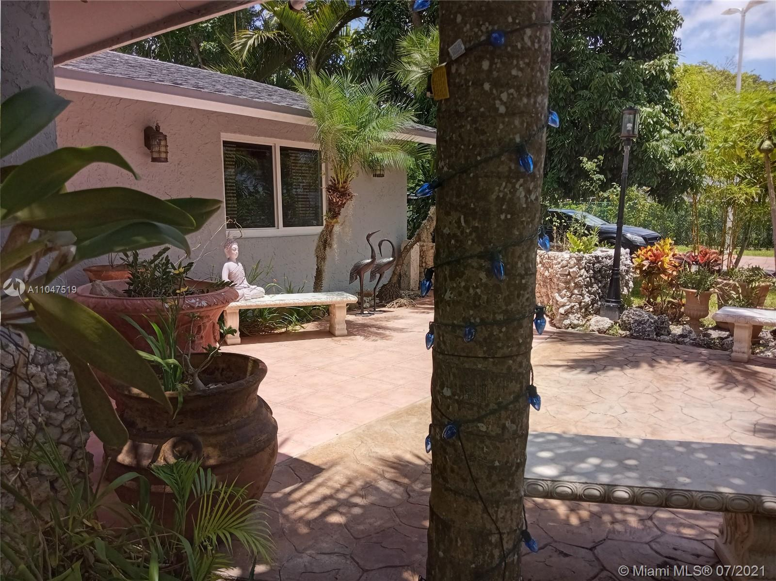 $675,000. Approx. 2,295' sq ft & more. Main house: 3 bedroom 2 bath, extra large family room, new top quality kitchen cabinets with Brazilian Granite counters, top of the line Samsung appliances, all new impact windows & doors. Plus 1 bedroom - 1 bath IN-LAW QUARTERS. New roof. Plus outdoor 1 half bathroom. Large all Teak wood Tikihut - bar with spacious sink & counters, fans, & plenty of lighting. Property has privately owned tall special lighting throughout, automatic gate, extra long driveways & walkways, new septic, new water well equipment, 16 cameras surveillance,. Expect low property taxes as Koi pond, & the variety of fruit trees have been applied for Agricultural Class., Mature greenery.