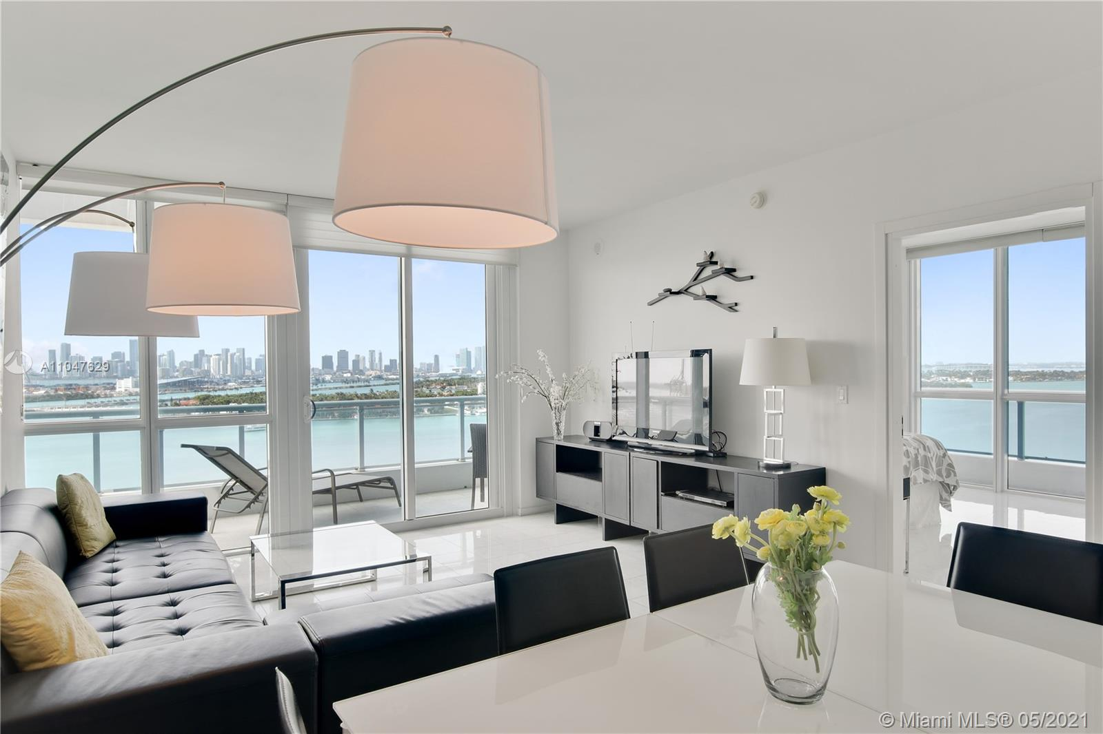 """Most desirable """"14 line"""" corner unit, with probably one of the nicest views Miami can offer: City skyline, Star Island, South Beach and the ocean. Both bedrooms have sliding glass doors leading to the wrap-around balcony with views from every angle! Stunning finishes includes: marble and porcelain floors, European cabinetry, marble countertops and stainless steel appliances. Amenities includes: swimming pool overlooking the bay, Jacuzzi , exercise center, sauna and steam room, 24 hours concierge and valet. Exceptional location with 100% walkability to the beach, shops & restaurants, minutes away from Downtown and Miami International Airport. New Bentley Bay Marina with boat docks available for rent up to 65 feet long vessel. The furniture are included with the sale. Ready to move-in!"""