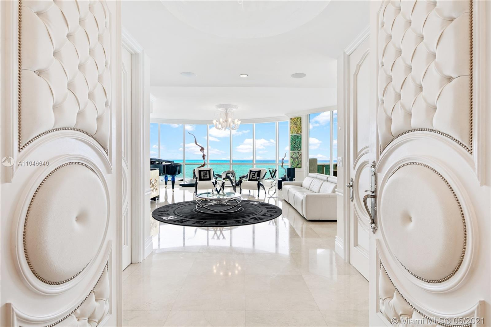 Live in luxury at Trump Palace in this one of a kind oversized residence consisting of two combined units in the line 07 and 09. This unit offers 5 bedroom 4.5 baths with infinite views of Miami's turquoise ocean and miles of beaches from the 3 expansive terraces. Private elevator professionally designed & decorated: Murano Glass Chandeliers with Swarovski Crystals. Bright open kitchen boasts Miele, Wolf and Sub Zero Appliances. The luxurious master suite features huge walk-in closets, and rare, exotic tiled shower and tub enclosure. Crestron Home Control System. Resort Style Living oceanfront with beach services, on a pristine beach with pools, jacuzzis, Restaurant on the beach, Tennis courts, Dog Pavilion, Spa & Gym, all the unique amenities from Trump Grande Resort, and much more.
