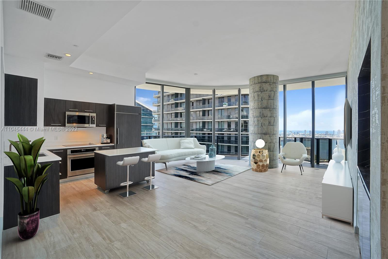 Boasting an array of sleek finishes and a thoughtful open plan layout, this immaculate 3-bedroom, 3 1/2 bathroom condo is a paradigm of contemporary Miami living. This stunning designer appointed 1,701 sq. ft. lower Penthouse features include wide plank engineered hardwood floors, 12 feet ceiling, floor to ceiling windows, central heating and cooling, and washer/dryer. Beyond a functional entryway space the home flows into a luminous, open- concept living, dining, and kitchen area. This lower Penthouse is on the 47th floor and has the incredible views of Biscayne Bay, Miami Skyline and Ocean to the East, North and South. This stunning condominium located right in the heart of Brickell city center steps to upscale shopping, dining & entertainment.