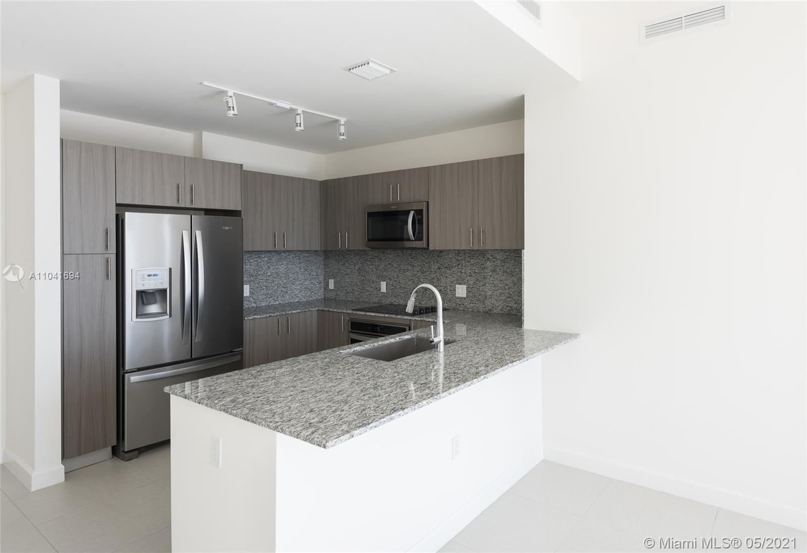 **NEW CONSTRUCTION** beautiful TOP FLOOR corner unit Pent House, only one in the market !!! Total living area (including balcony) according to arquitectural map of 1630 square feet with Golf course and Skyline views of Miami.  High ceilings, two central A/C unit, never lived on, hurricane rated windows, spacious laundry room, close to school and shopping areas. Amazing amenities on site.  Property on lockbox easy to show, PLEASE USE SHOWTIME FOR LOCKBOX CODE!!!