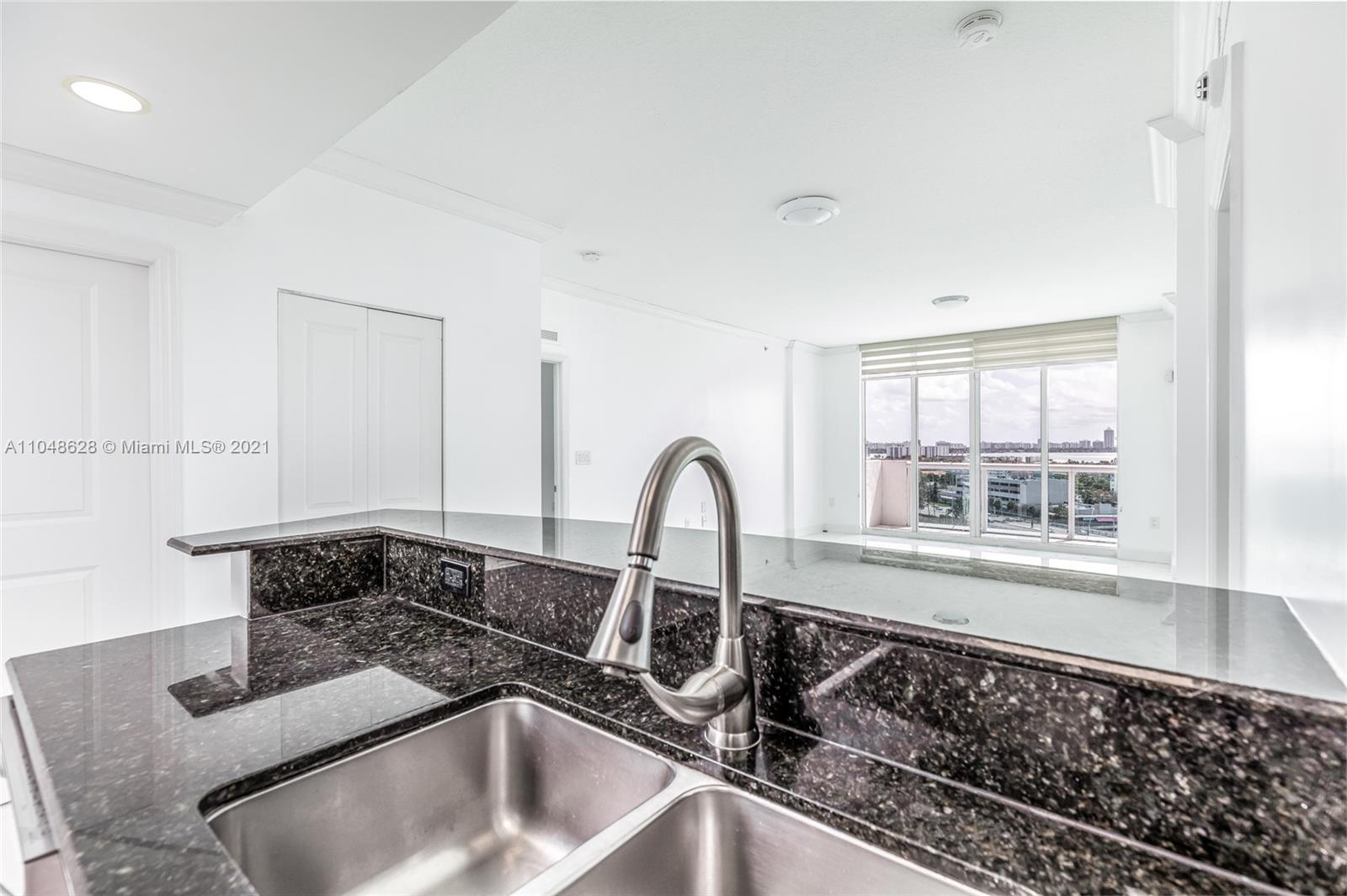 Amazing unit at the 360 condominium!! Fully Remodeled!! Featuring 2 Bedrooms and two baths, beautiful views from all rooms, panoramic floor to ceiling impact windows and sliding doors, expansive balcony, master bath with dual sinks and shower heads, fully equipped open style kitchen with stainless steel appliances and granite counter-tops, washer and dryer inside and plenty of natural light! Building offers a variety of amenities including a gym, sauna, two pools, clubhouse, marina and provides 24 hr gated security with valet and guest parking.