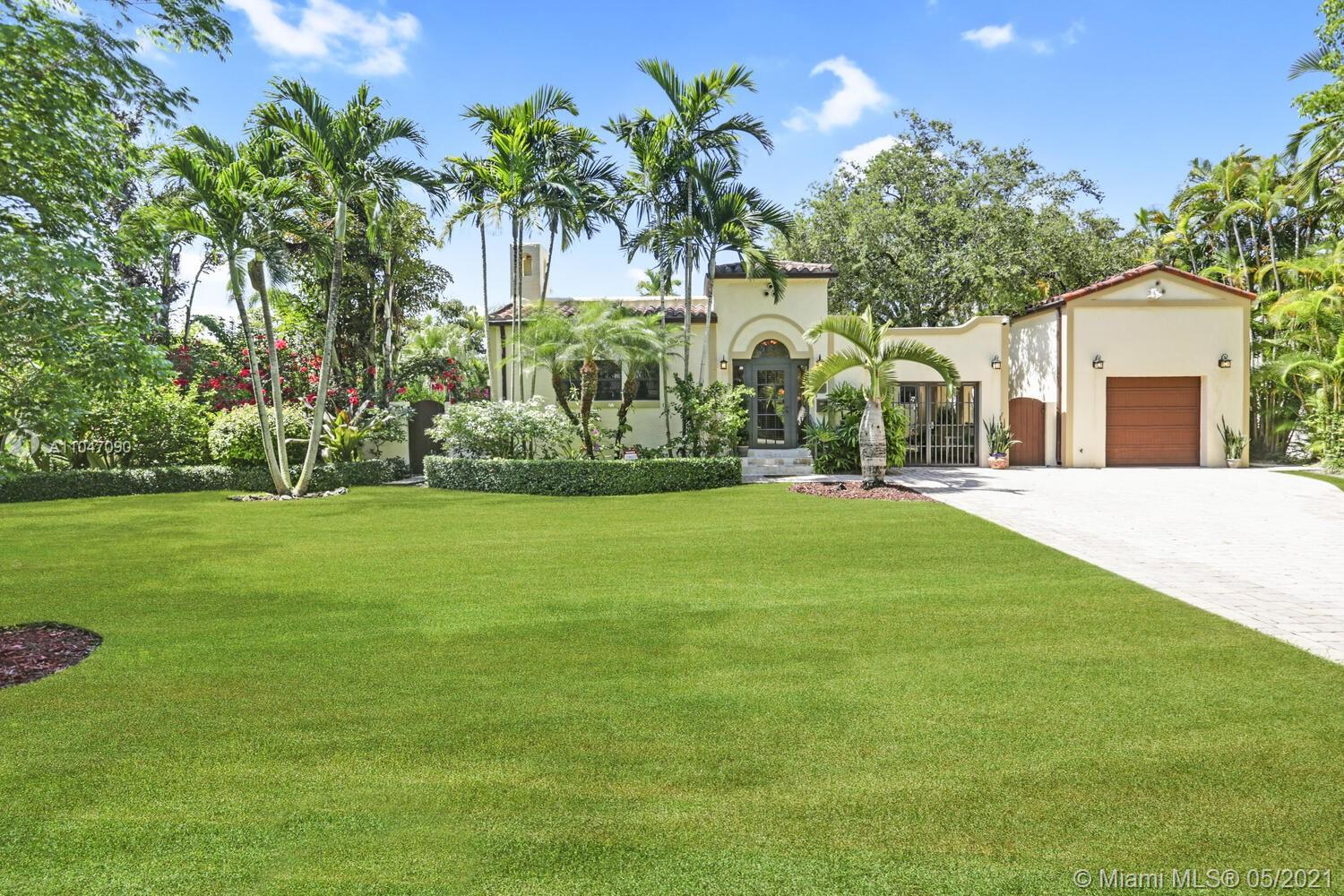 This stunning 4/4 Old Spanish home embodies 1920's Coral Gables charm & style, while boasting 2020's luxury & convenience. With full impact glass, updated kitchen & baths, electric, plumbing & roof, this beauty is completely turn-key. The open floor plan, high ceilings, gorgeous Brazilian cherry wood floors, sunken marble Roman tub, sparkling pool and professional landscaping are just a few of the impressive features not to be missed. The separate in-law suite (4th bedroom) has a private entrance - perfect for guests or extended family. In addition to multiple courtyards, there is a carport and an air-conditioned 1-car garage with loft storage area. Nestled on a lush, sun-dappled street, within walking distance of the Riviera Golf Course and the University of Miami. This is the one!