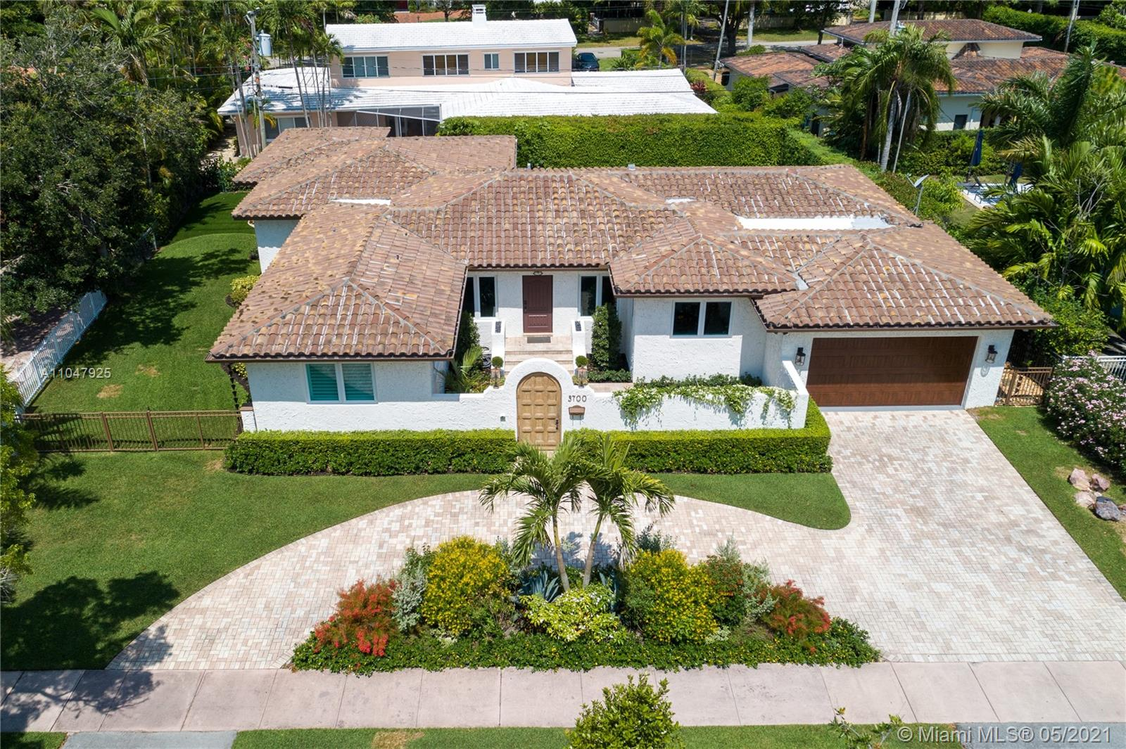 Sophisticated and charming, single-story, 4 bdrm/3 bath home within the Golden Triangle of Coral Gables. Extensively updated with 3000 adj. sq. ft., on a 10,900 ft. lot features a beautiful courtyard entry, impact doors/windows. There is a new 2020 gourmet, eat-in kitchen with top-of-the-line appliances, and a sunny breakfast area. Formal living and dining rooms plus a cozy Family room. To the left of the living room are all the bedrooms. The spacious master has walk-in closets and French doors to the patio/pool that features an infinity fast-lane resistance machine. The pool can be seen through French doors from many rooms in the house. The 2-car garage has a Clopay door and epoxy floors. Separate laundry room with a built-in desk/office area and a Standby generator. FIRM PRICE.