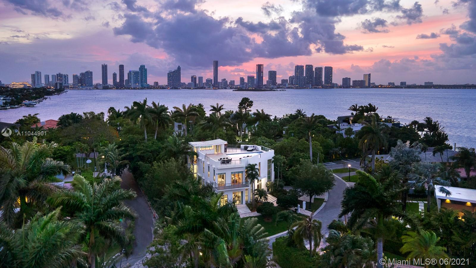 One of a kind contemporary new luxurious home w/ gorgeous 1,900 sq ft rooftop pool terrace. Sitting on a 7,500 sq ft corner lot, boasting a 15 x 30 negative edge swimming pool w/ breathtaking 360-degree panoramic views of Biscayne Bay (incl. gas, water, elec. outlets for bar/bbq/jacuzzi). Welcoming you with a 10'+ ceiling height w/ double-height entryway, elevator to all 3 floors, smart touch (color panel) lighting system, tankless gas w/h, high-end plumbing and elec. equip. Deluxe master bath: spa, sauna, bidet, all bedrooms with en-suite baths, equipped w/ Kohler infinity soaker tub, etc. Spacious playroom room under the pool is fun for kids.